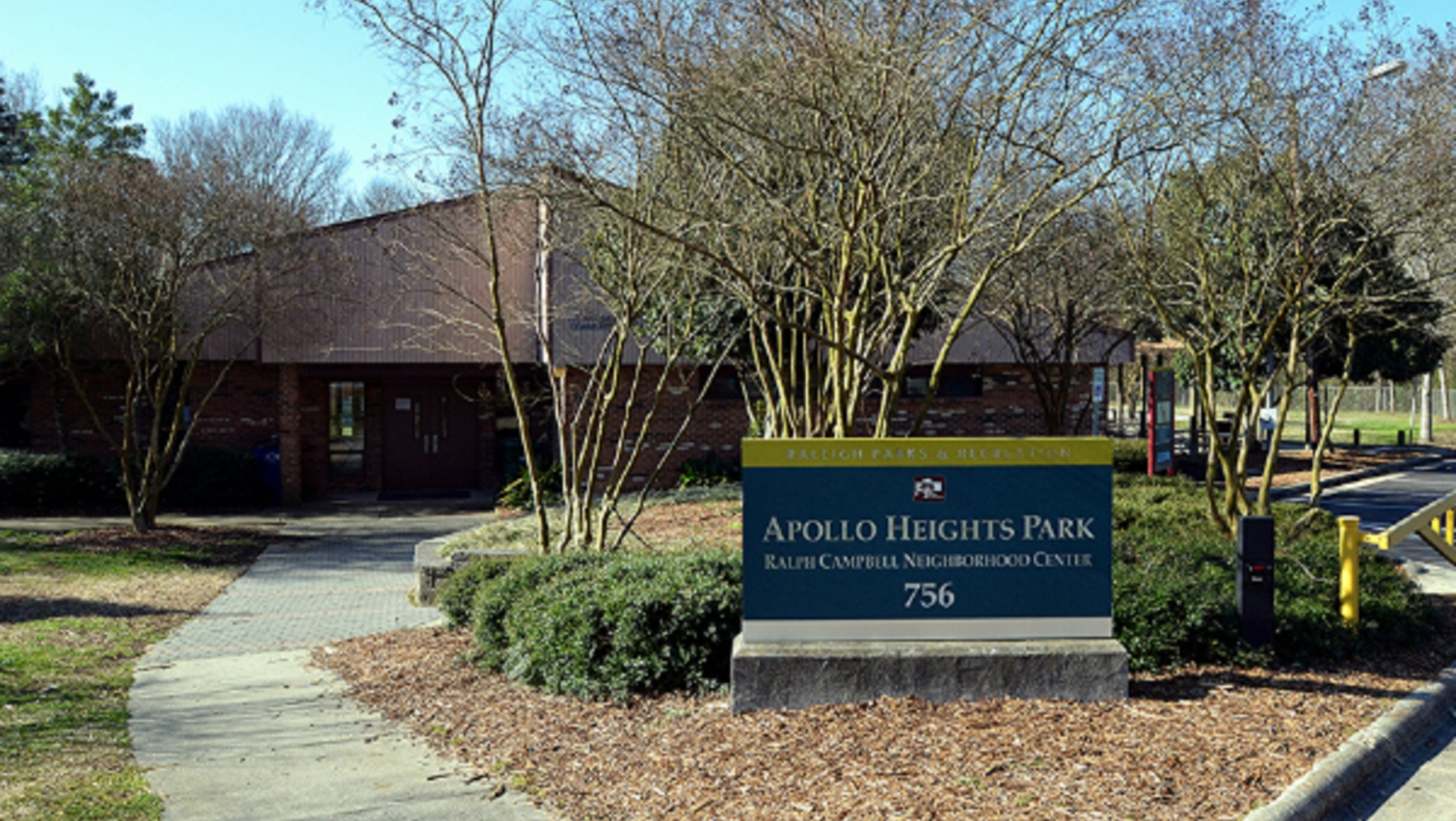Sign and front of brick building that is the Apollo Heights Community Center