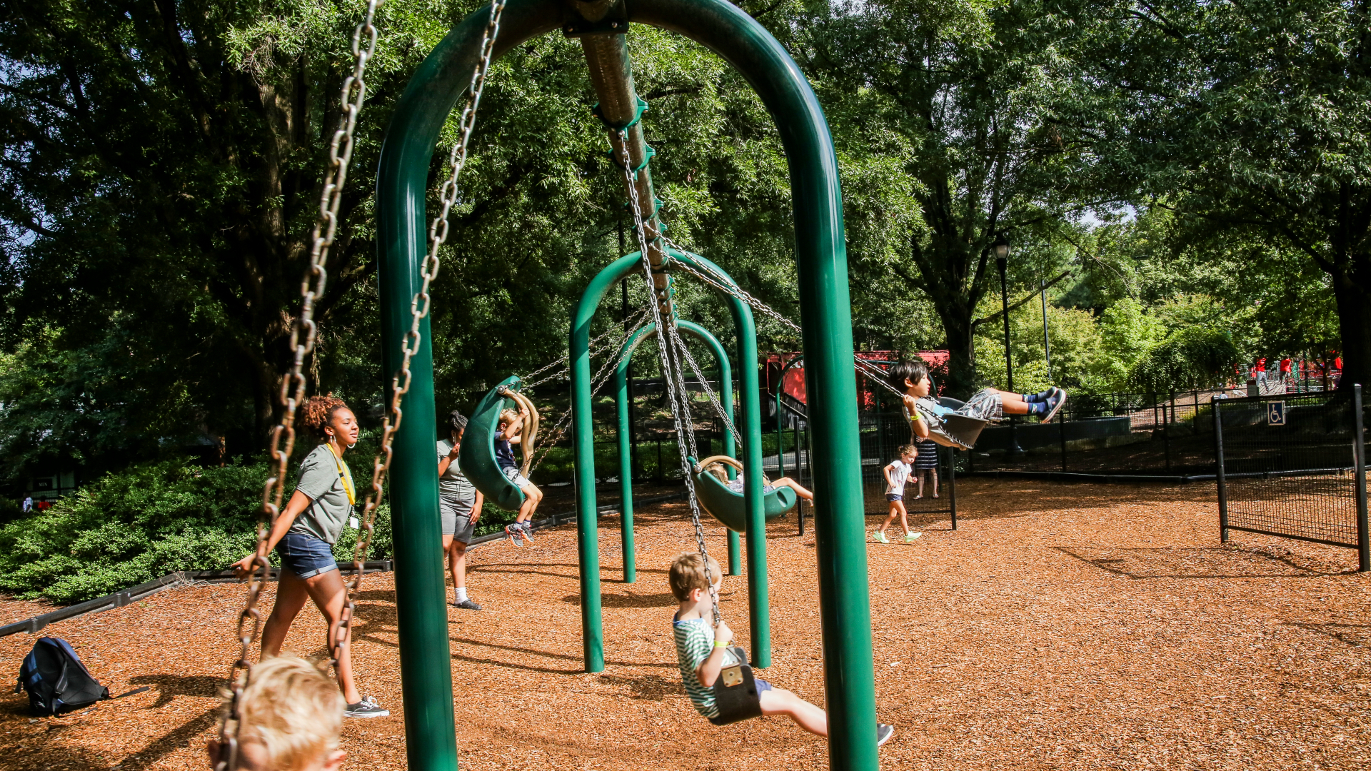 Kids swinging at Pullen Park playground