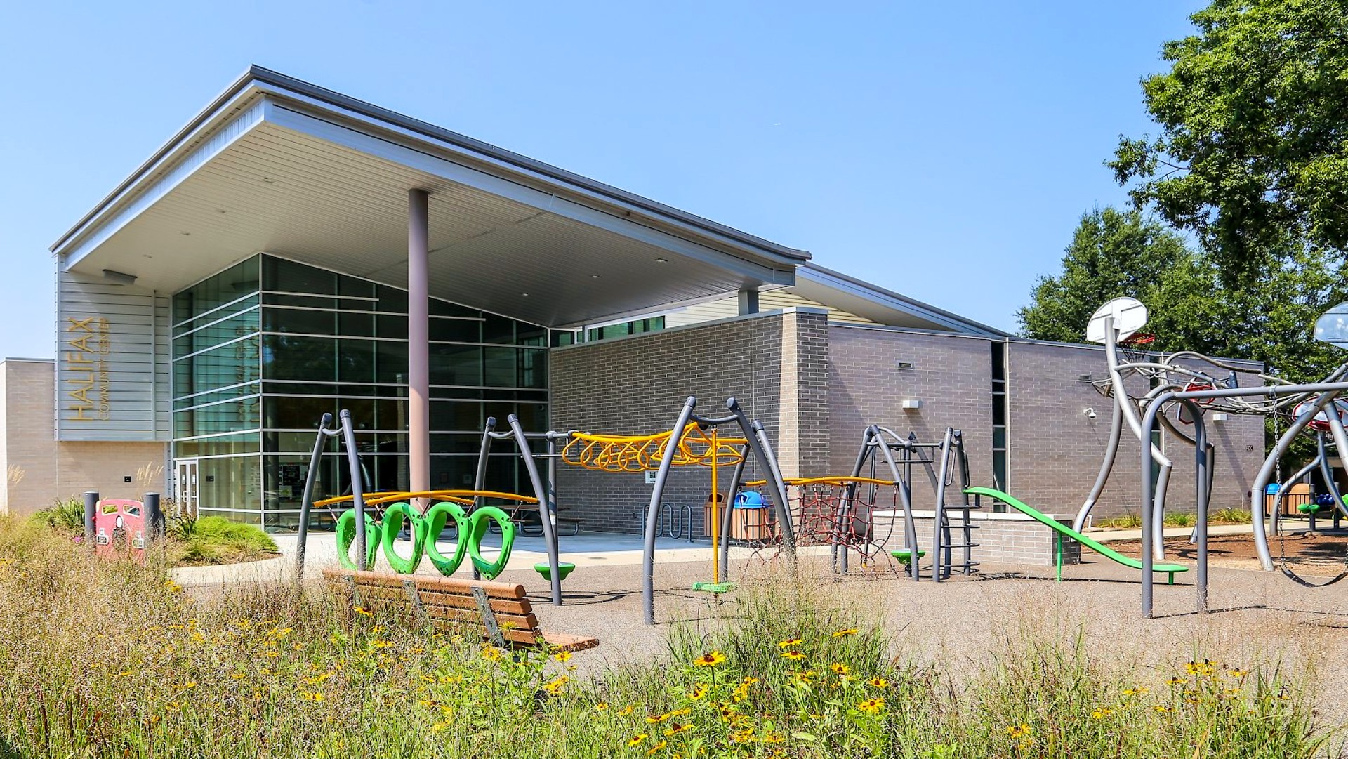 playground with monkeybars and other climbing equipment at the front of the Halifax Community Center