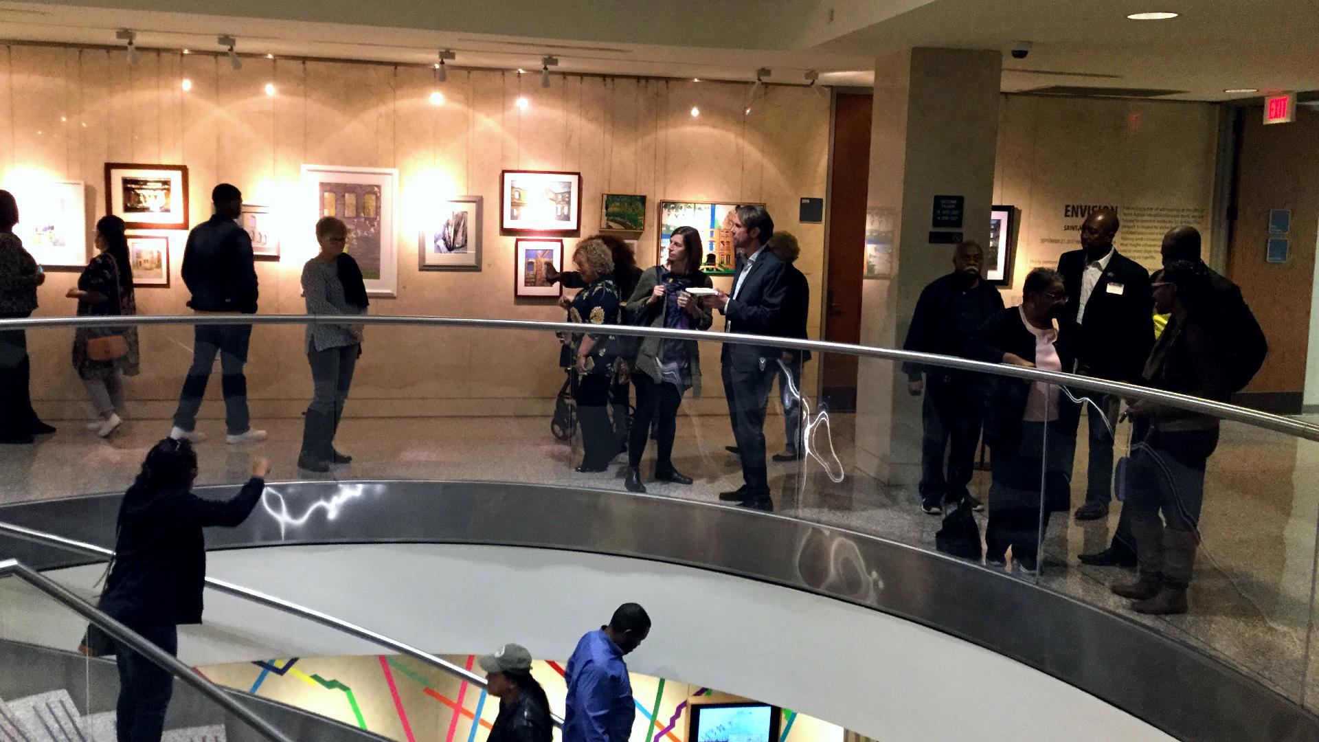 people gathered in a gallery space
