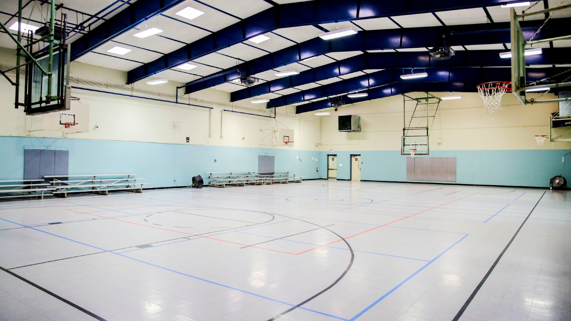 empty full court view of gymnasium inside chavis park community center