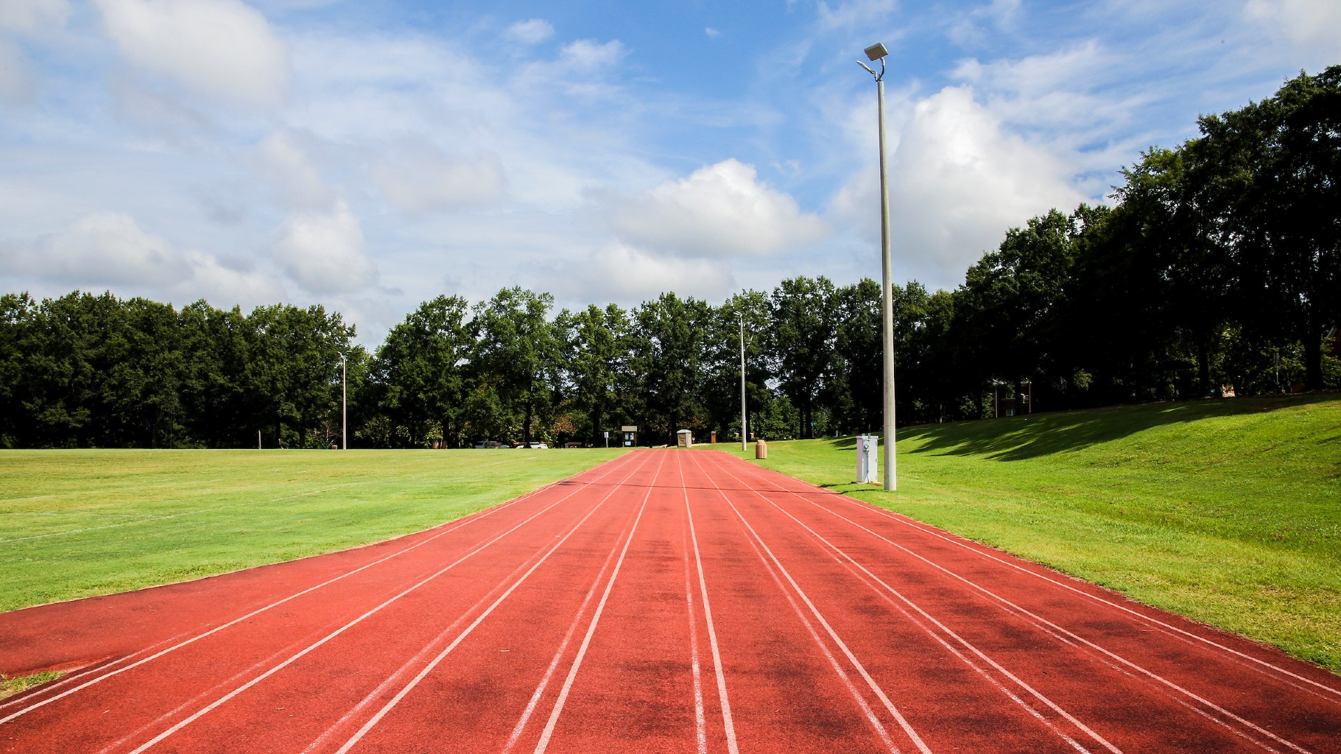 track lanes with grassy field at chavis park