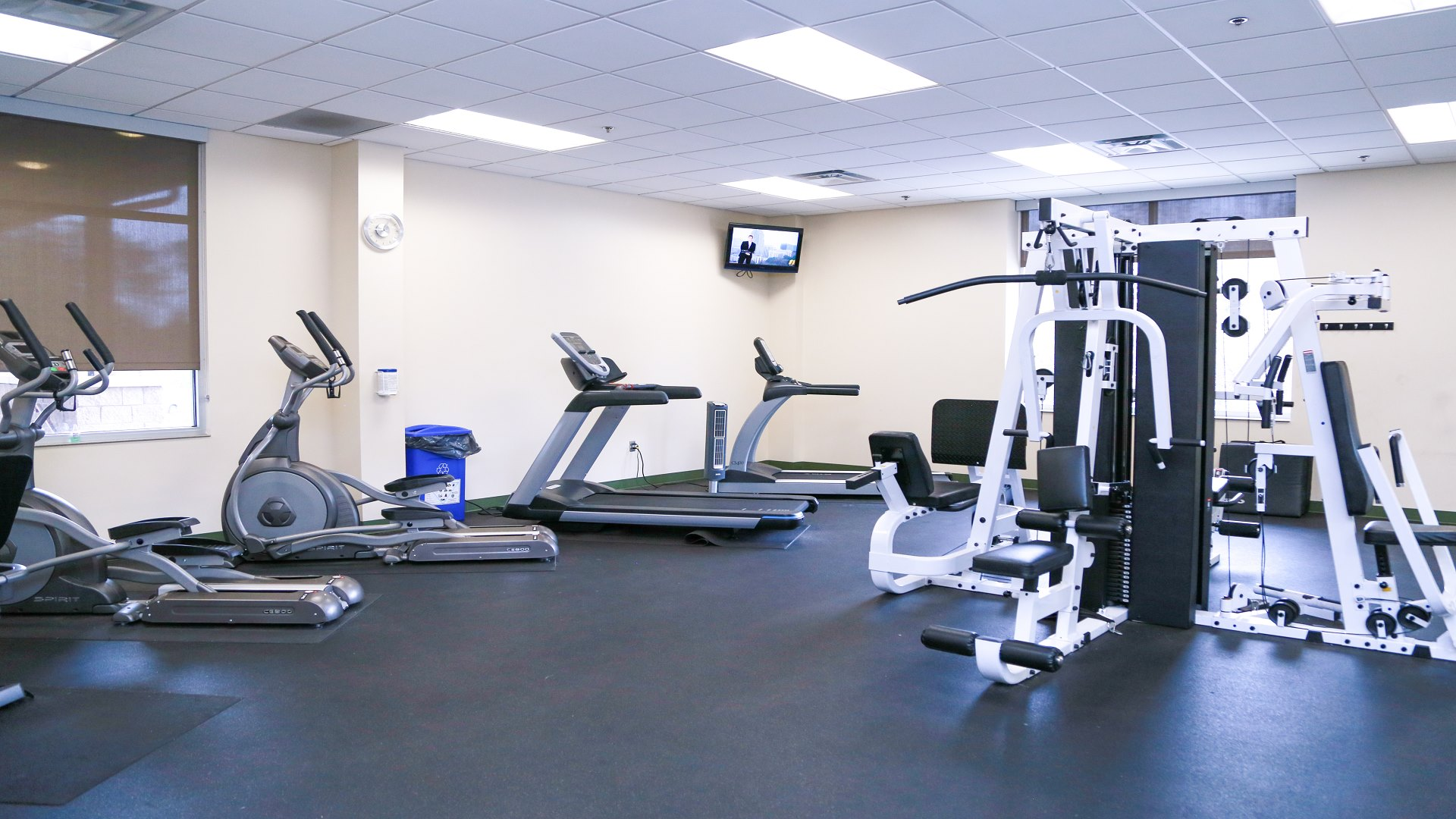 An indoor fitness room with equipment and a stretching station at Marsh Creek