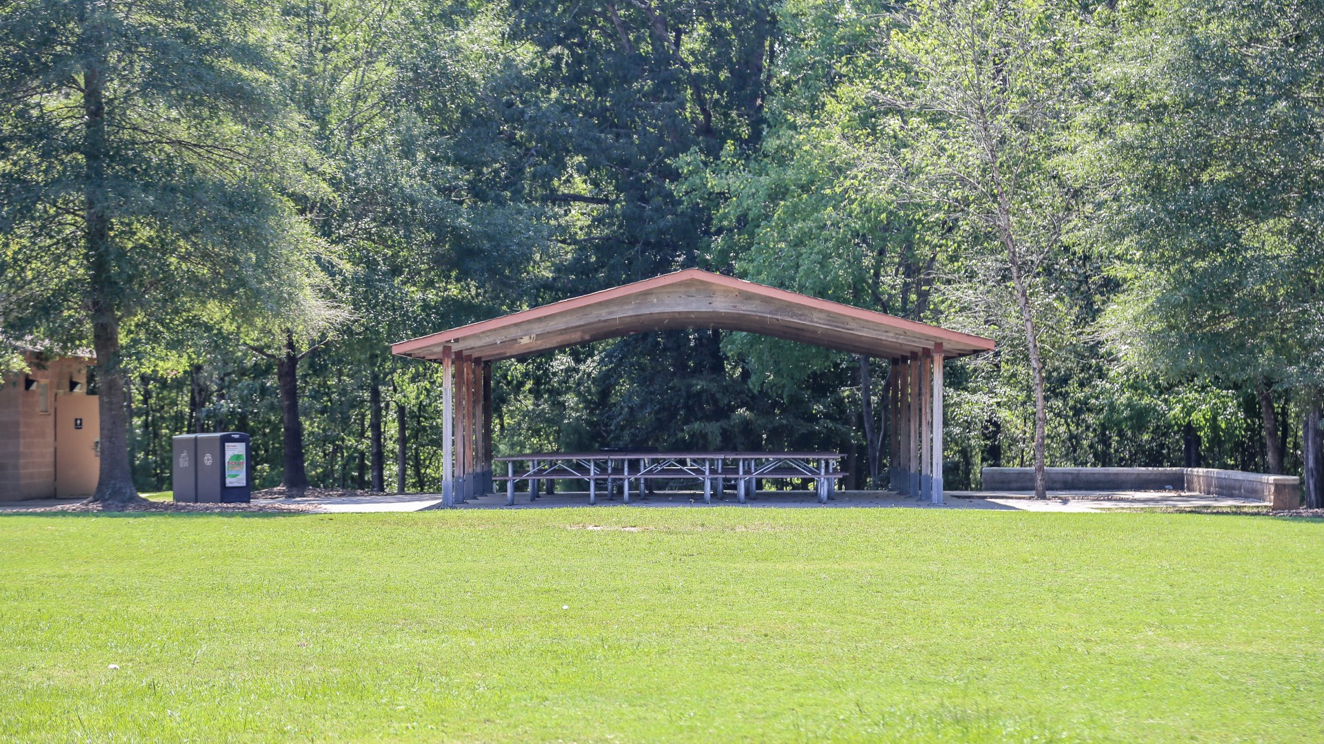 A second smaller picnic shelter with 12 tables near the restrooms