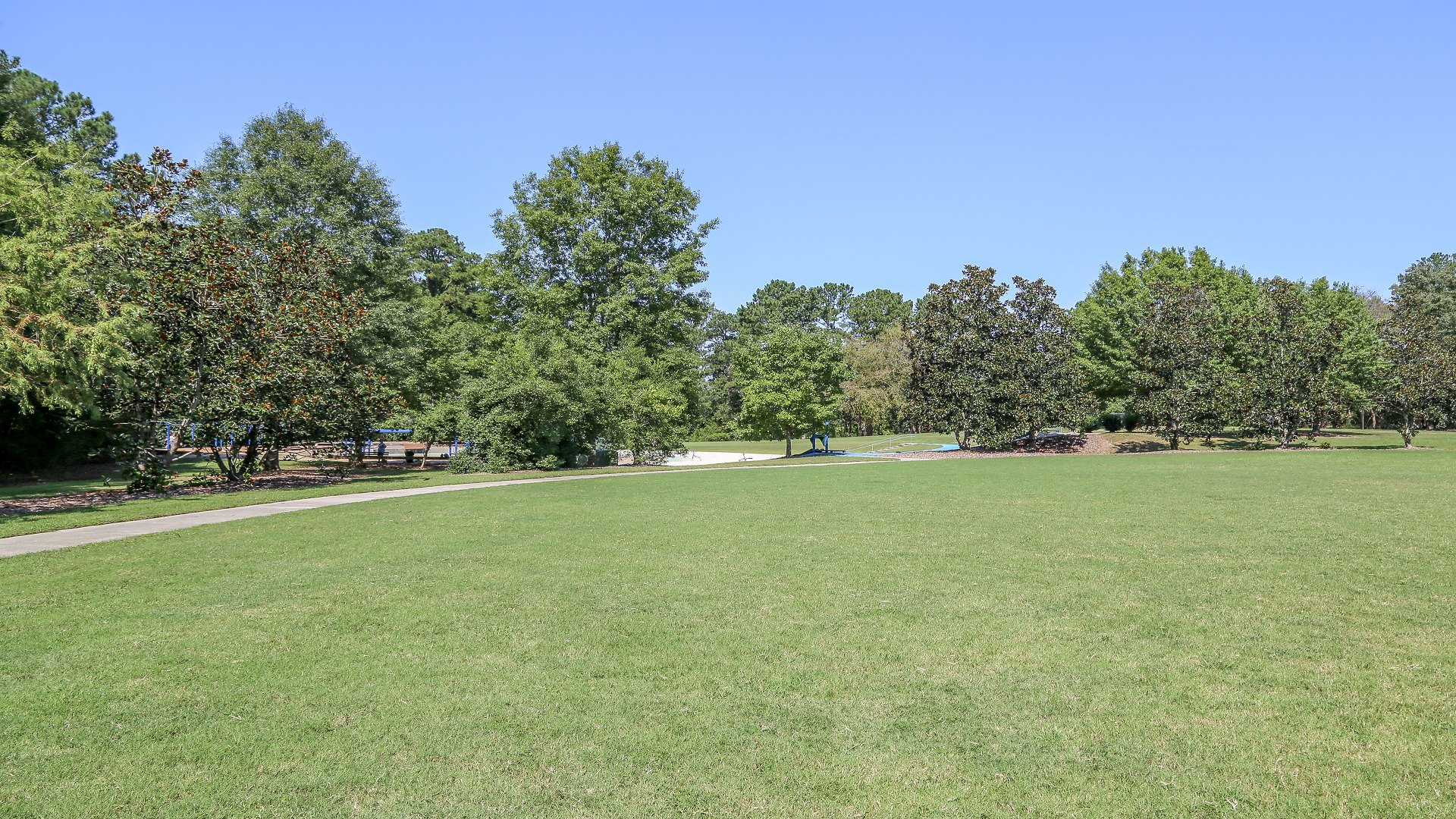 A large open space located next to the playground