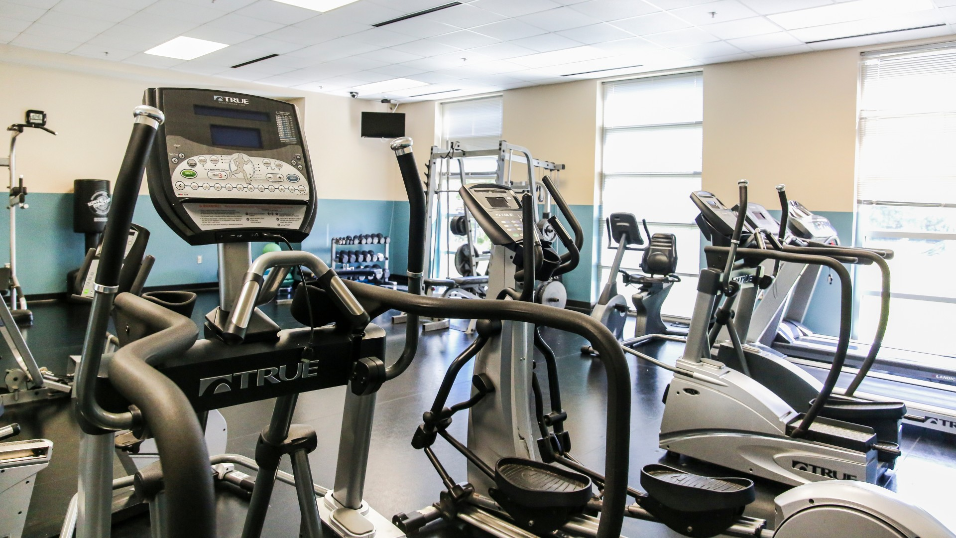 part of Barwell Road Park fitness room with treadmills, bikes, and free weights