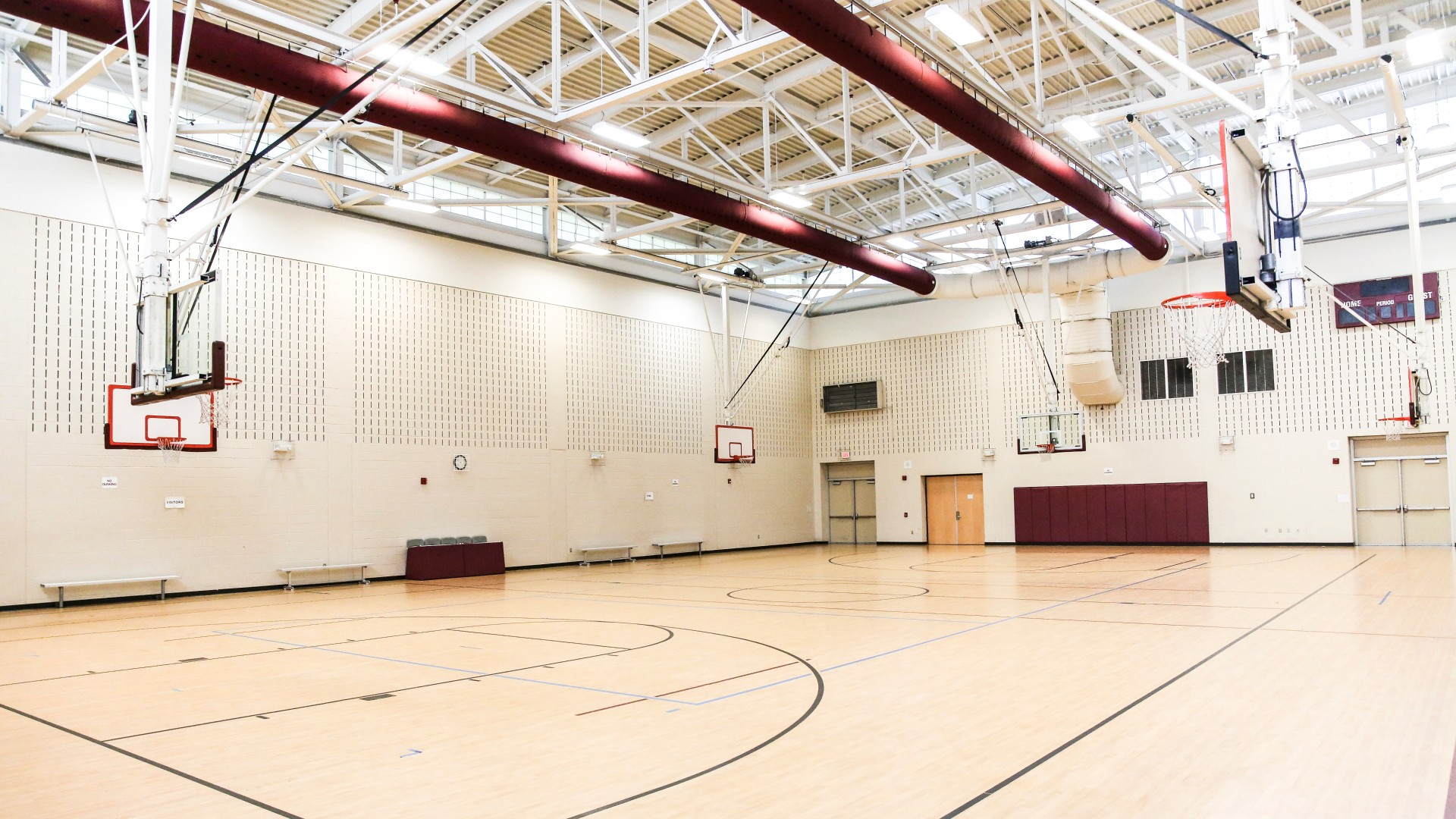 Barwell Road Park gymnasium featuring multiple basketball hoops and open floor