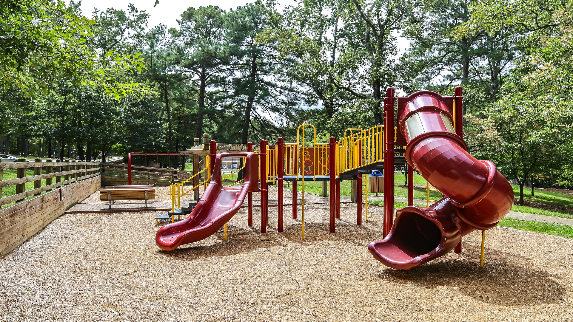Playground with slides, swings and more on a woodchip surface at Biltmore Hills Park