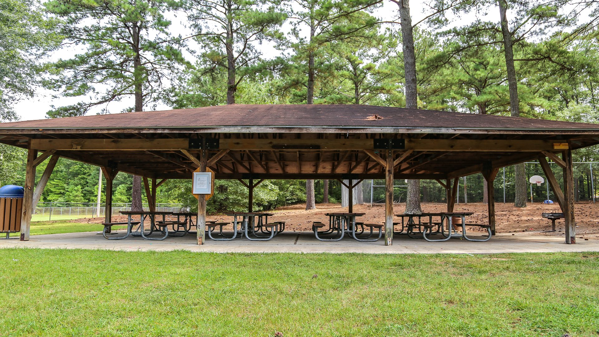 Outdoor picnic shelter with eight tables at Biltmore Hills Park