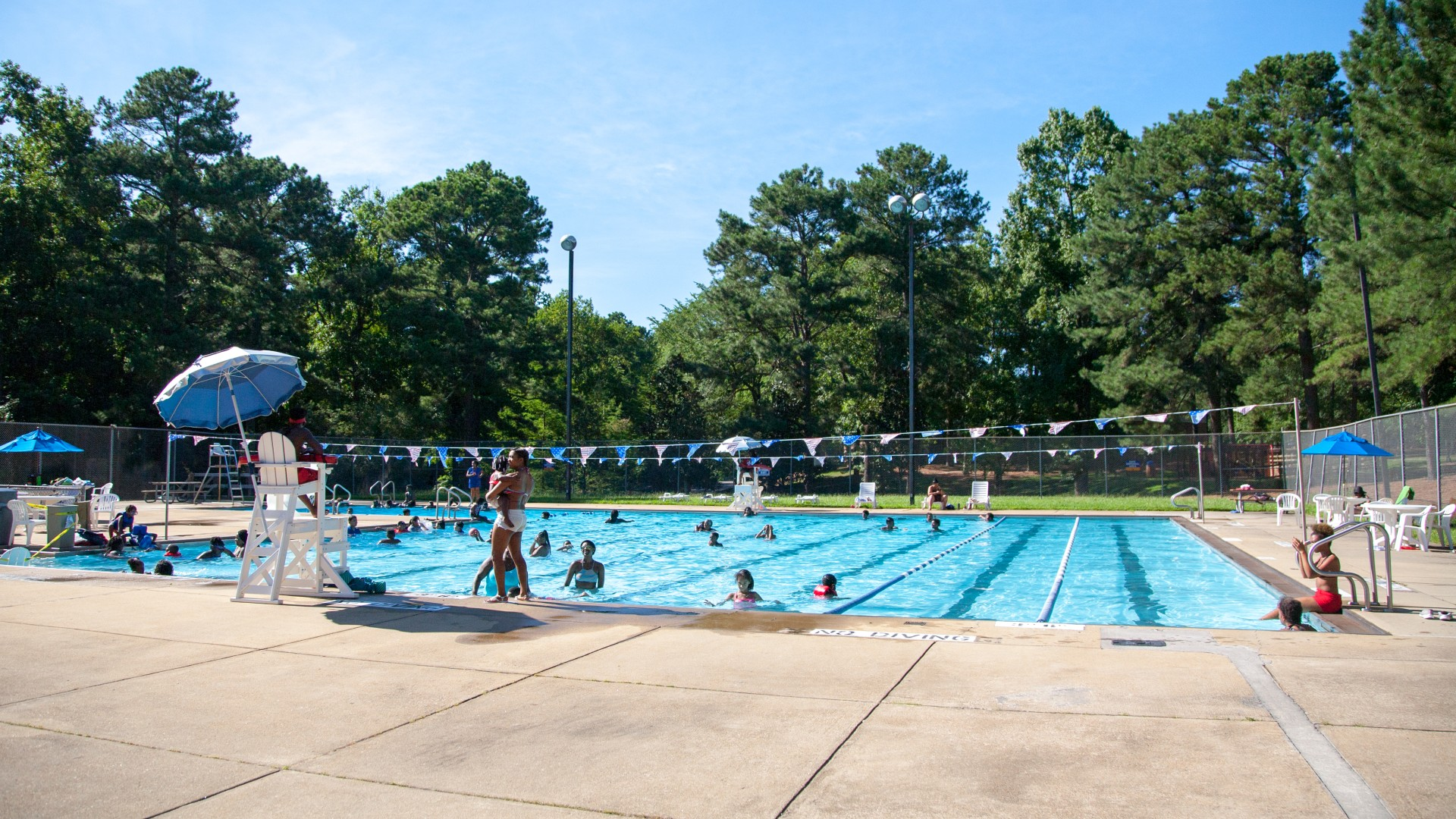 People enjoying the Biltmore Hills pool in the summertime