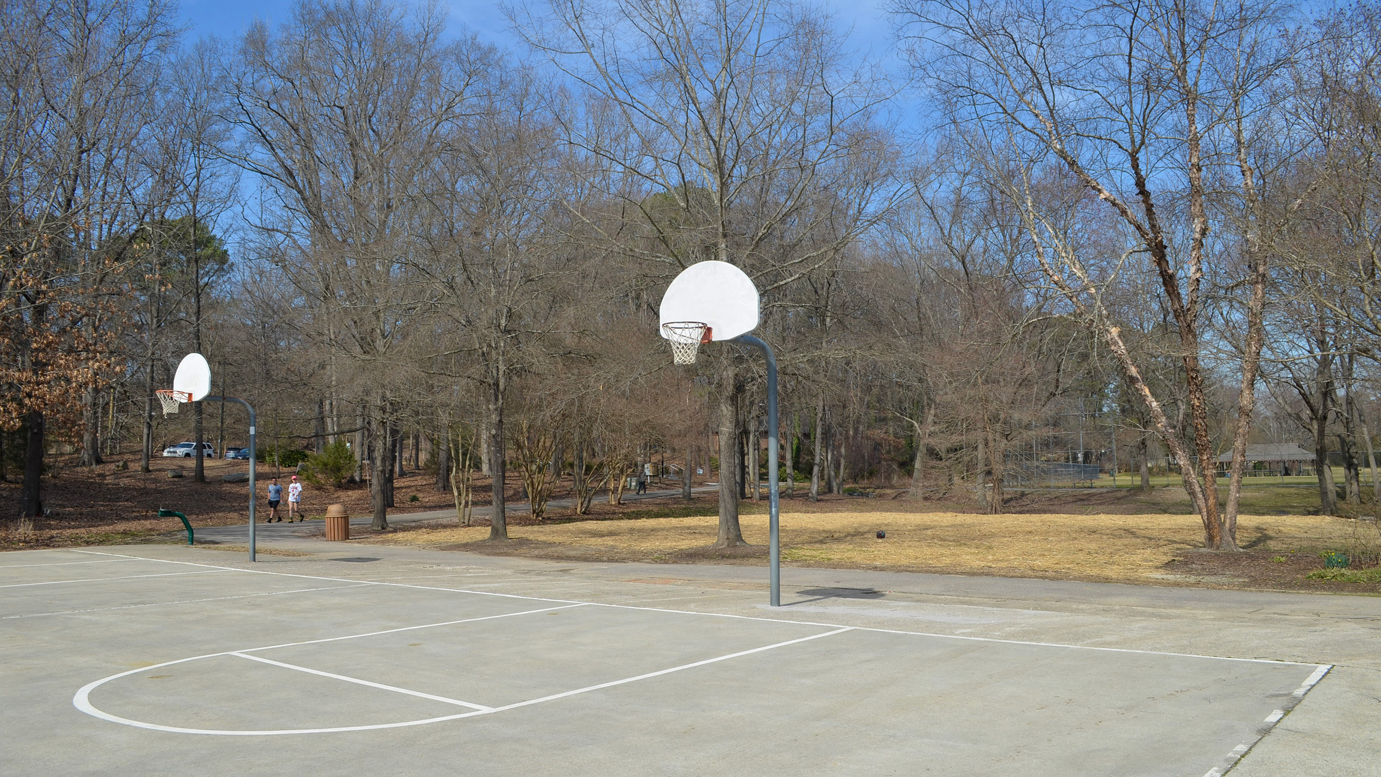 Boys playing at the outdoor basketball courts at Brentwood