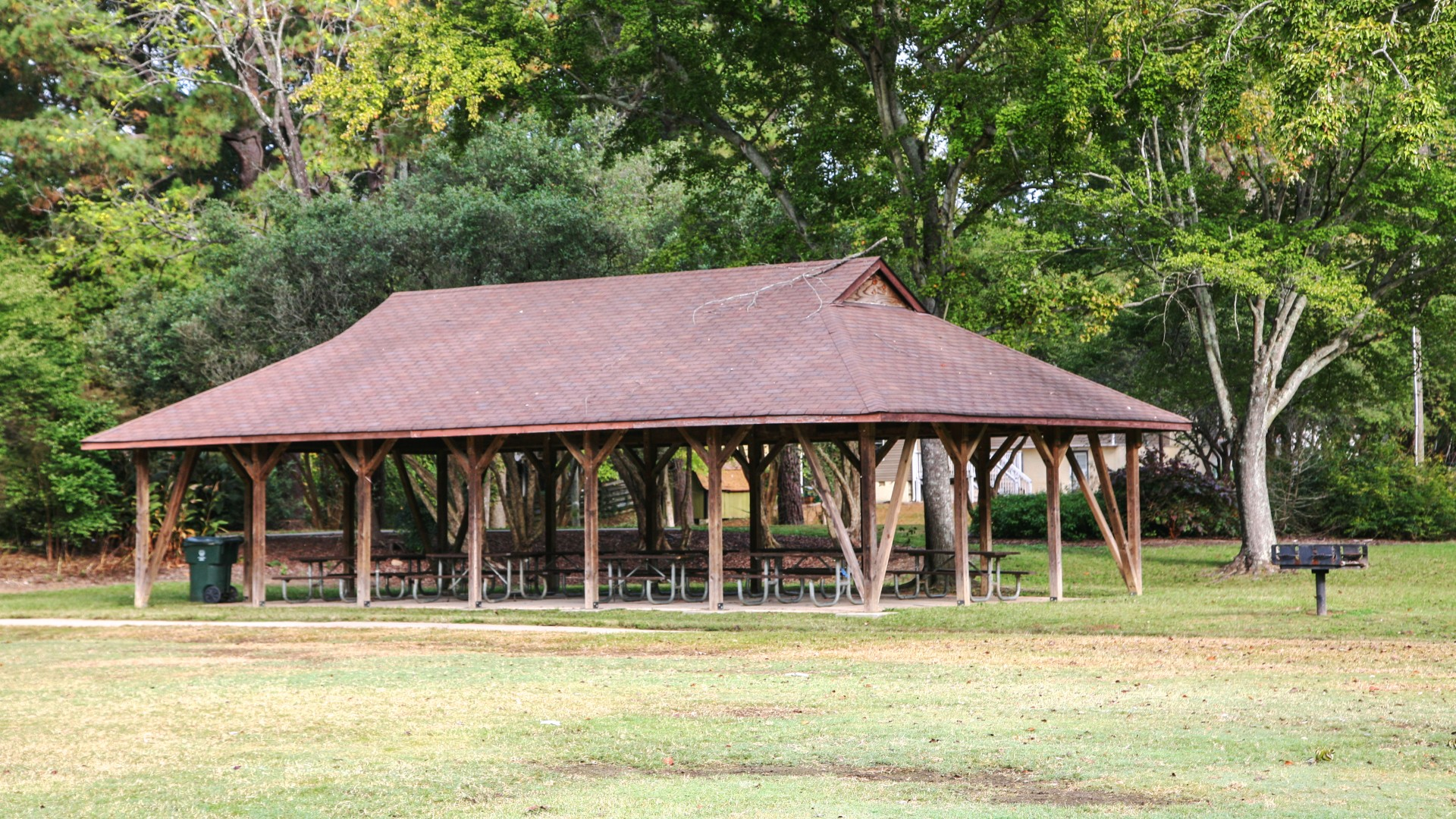 A large outdoor picnic shelter with multiple tables at Brentwood Park