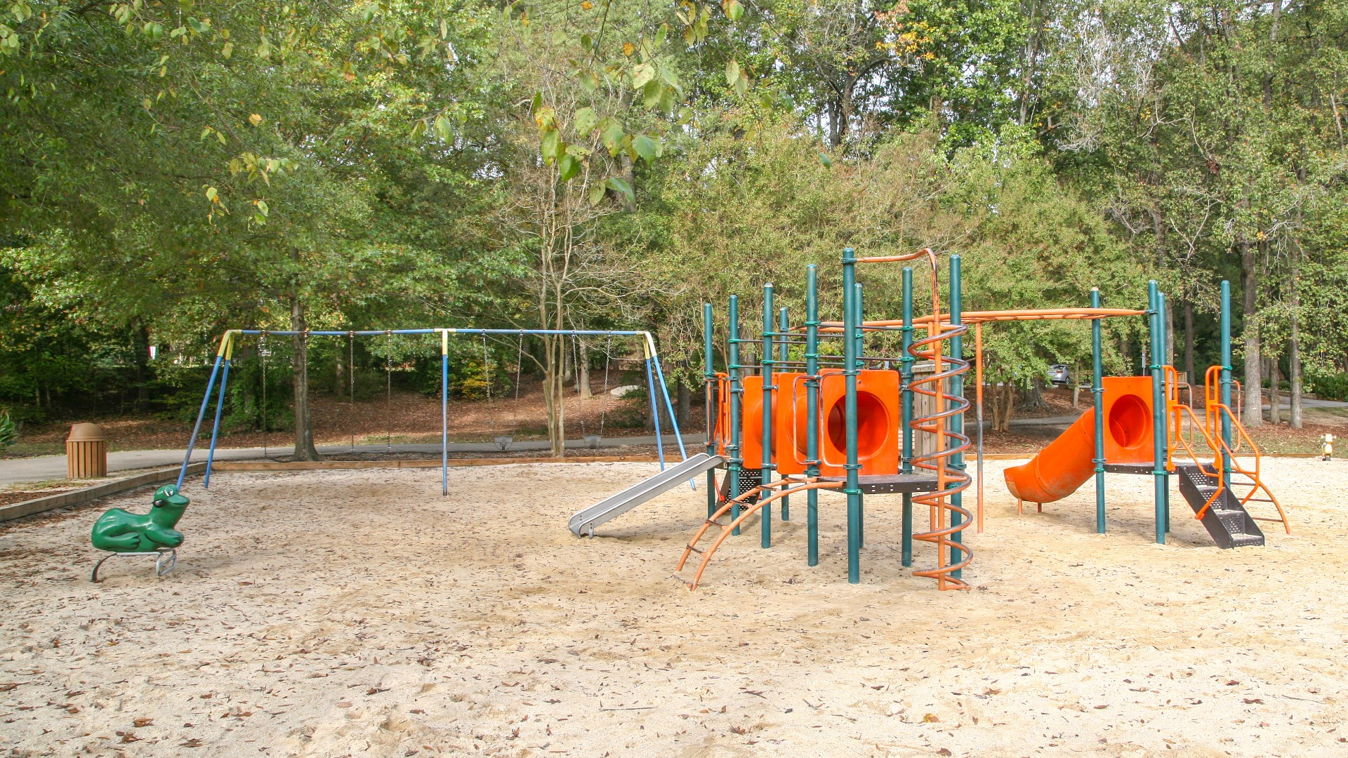 A playground with swings, slides, and more at Brentwood Park