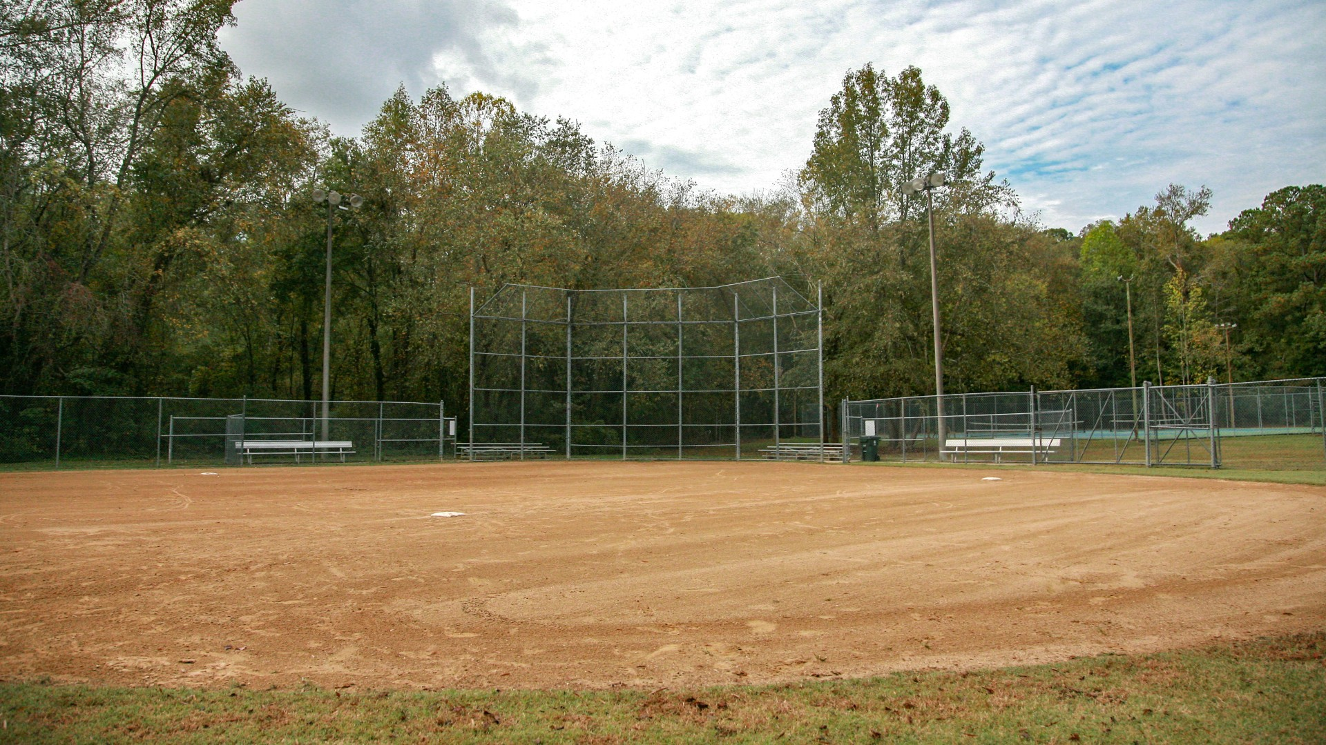 An open youth baseball field located near the tennis courts at Brentwood Park