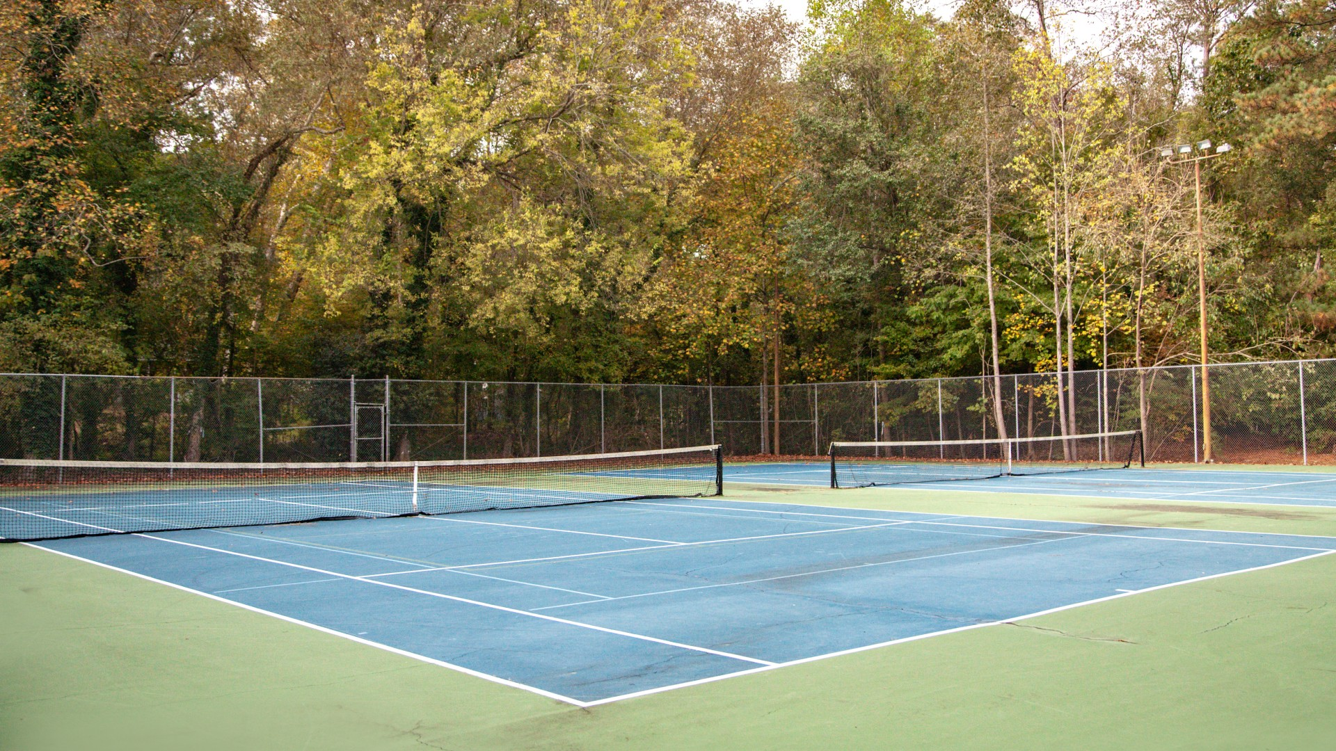 Two outdoor tennis courts at Brentwood Park