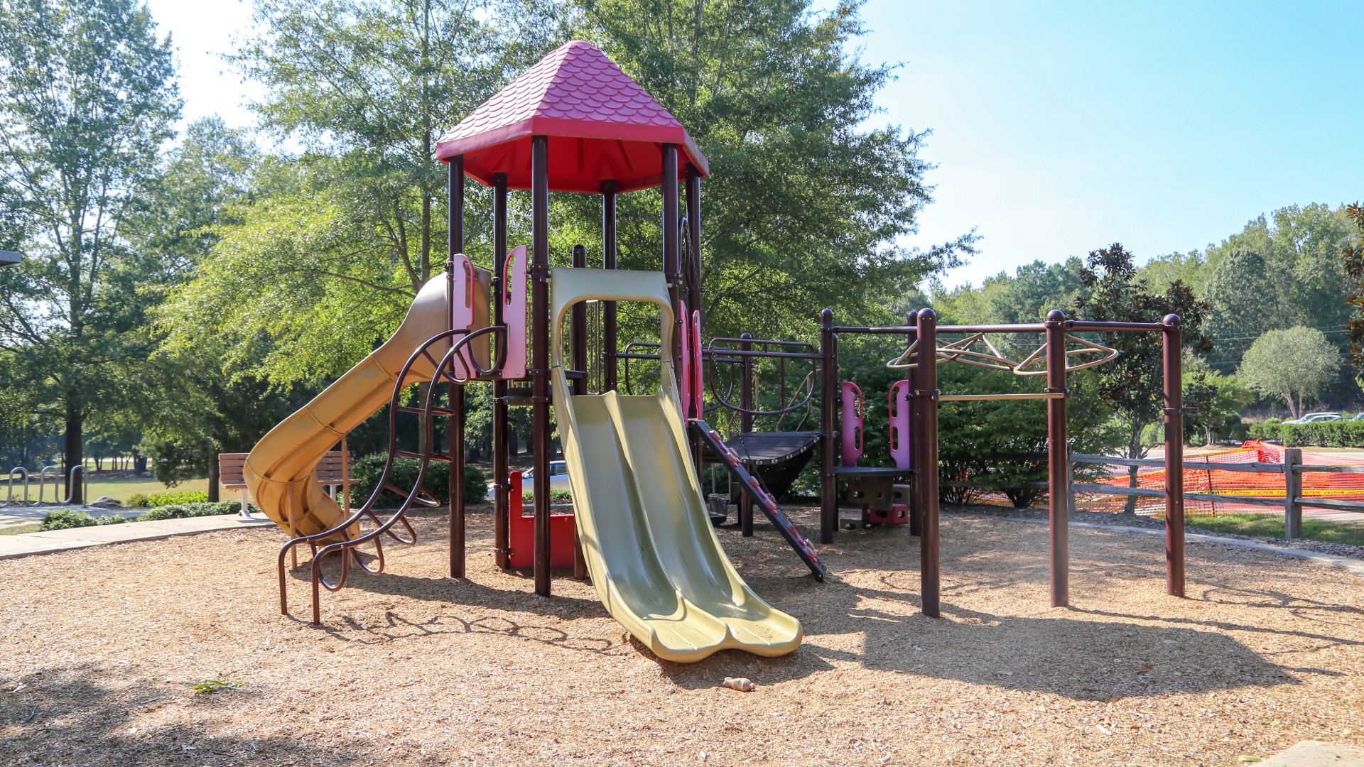 A larger playground at Buffaloe Road park with three slides, a bridge and more