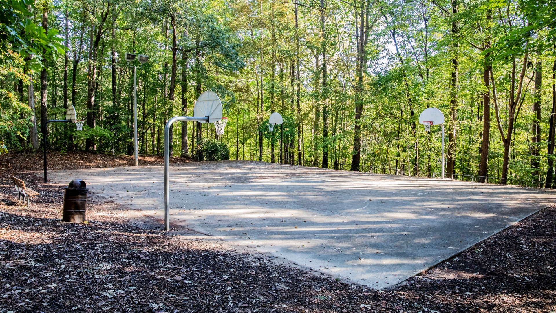 Outdoor basketball court with four baskets at Cedar Hills Park