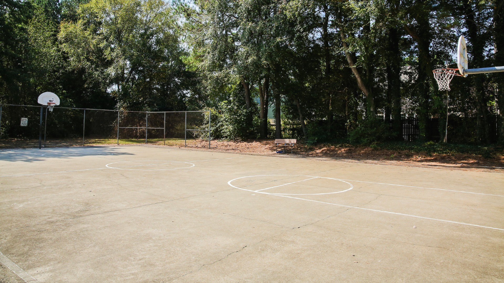 empty outdoor basketball court at millbrook park