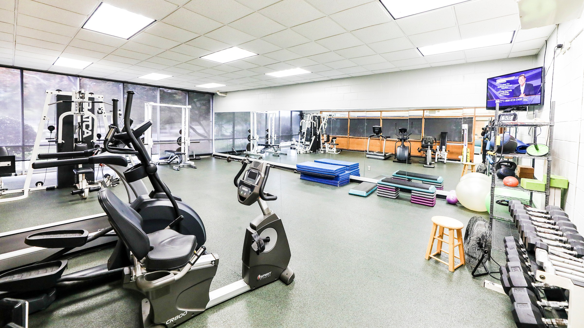 weight and cardio machines in fitness room at Millbrook Exchange Park
