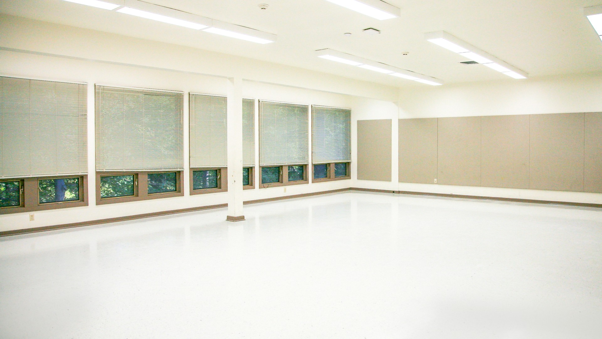Large multipurpose room at Glen Eden Pilot Park featuring lots of open space and large windows