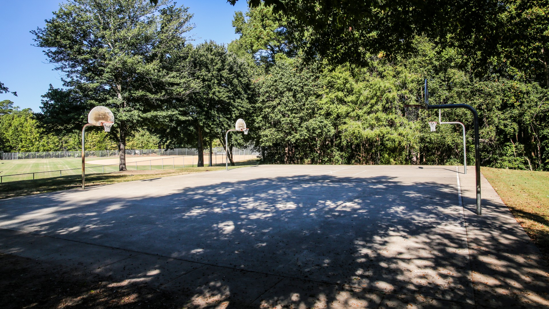 Shot of the two outdoor basketball courts and hoops at Green Road Park