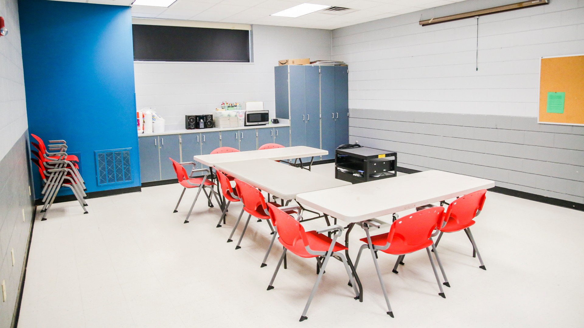A smaller classroom at Green Road Park with chairs around a table and counterspace