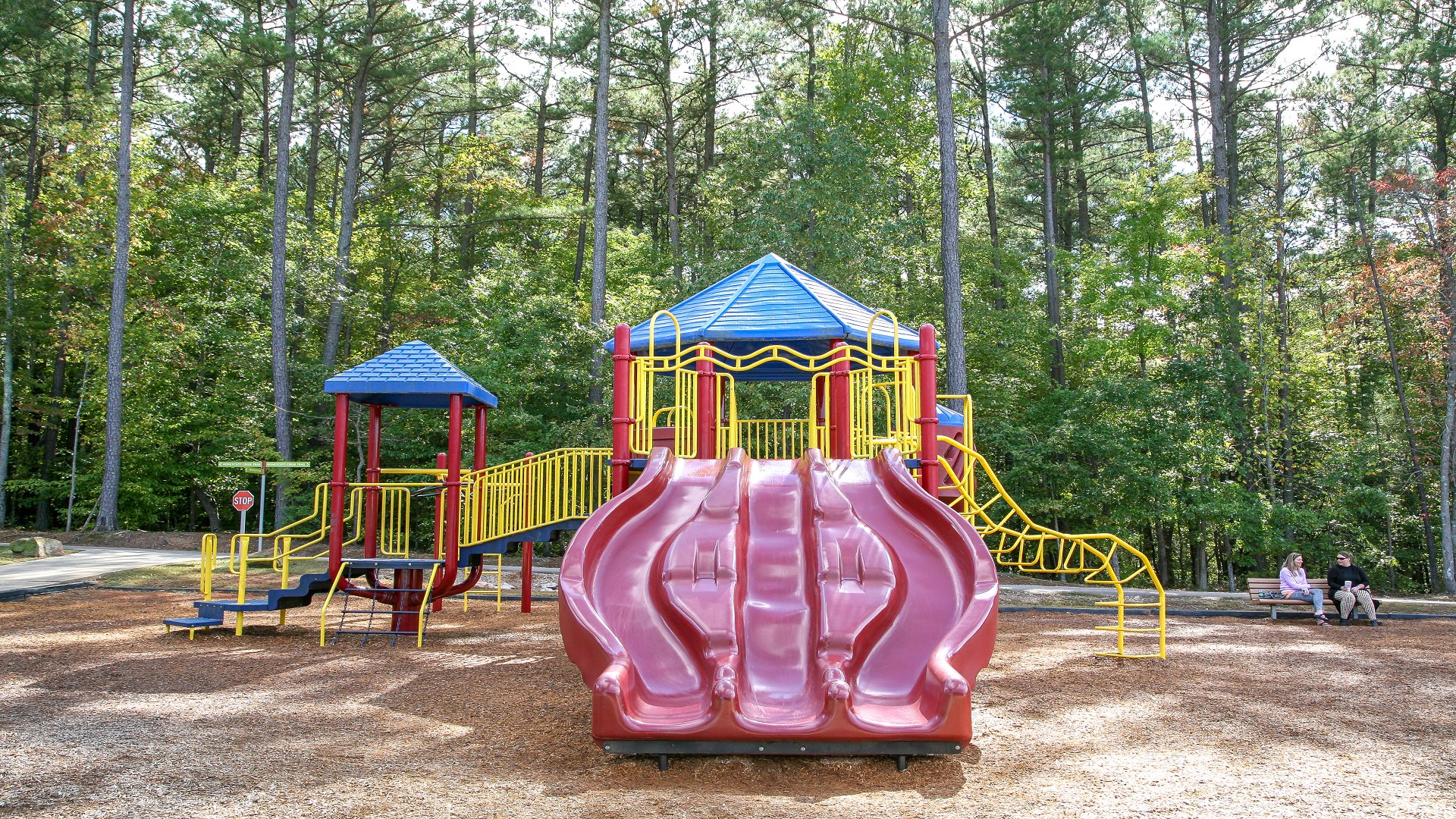 Honeycutt Park playground with multiple slides. For ages 5-12