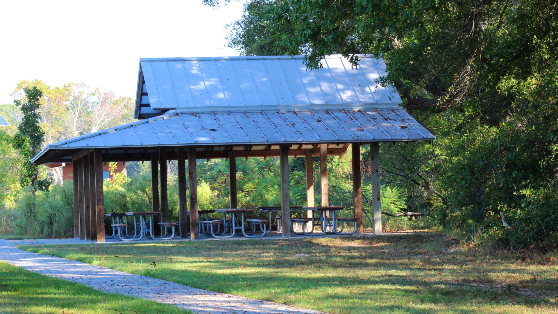 A side shot of the outdoor shelter with six picnic tables at Horseshoe Farm Nature Preserve