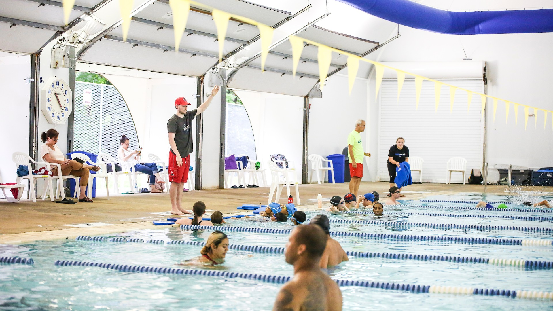 Instructor teaching a swim class at Millbrook Exchange Pool in Raleigh.