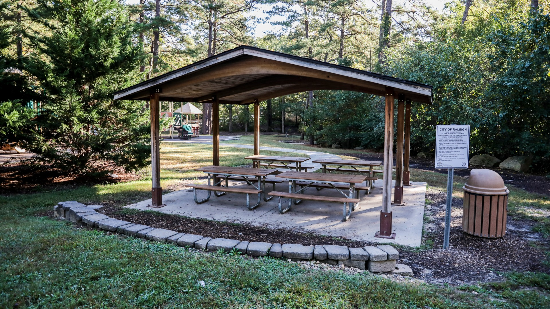 Picnic shelter with four tables and one grill at Kentwood Park
