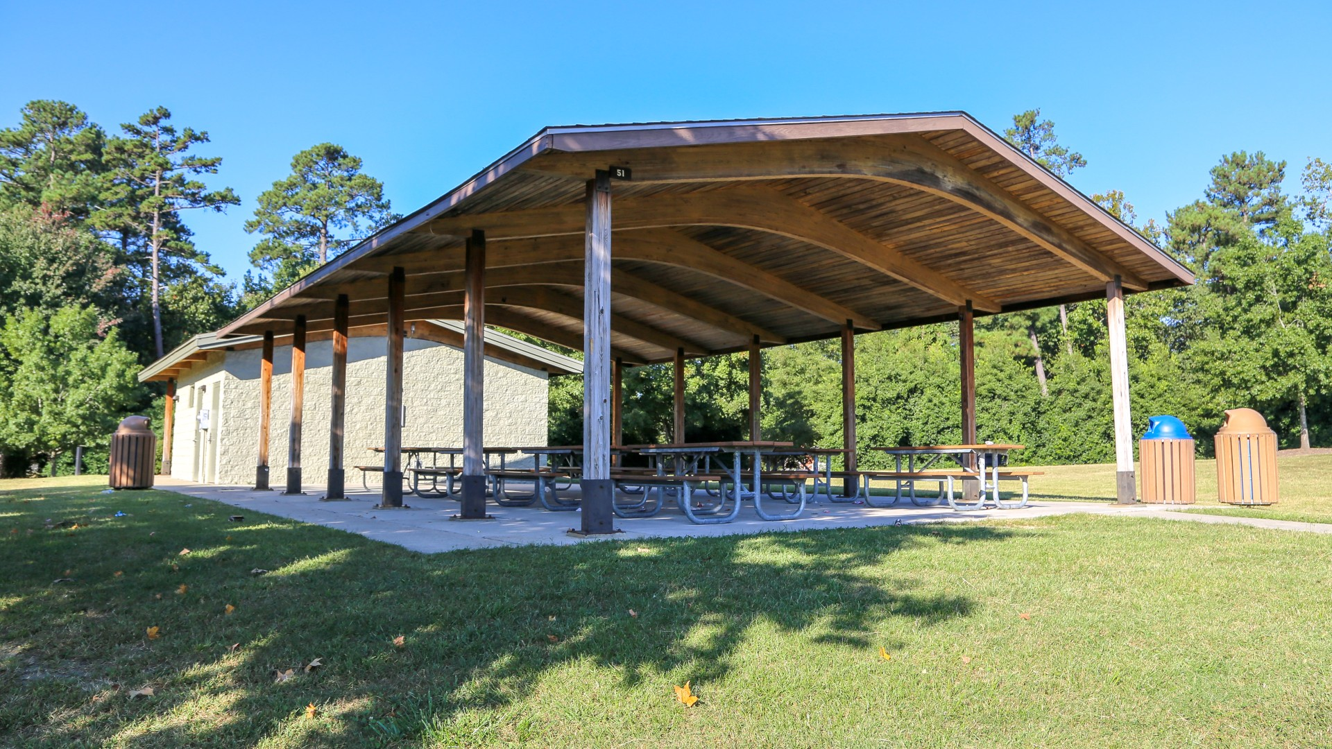A large outdoor picnic shelter with several tables at Marsh Creek