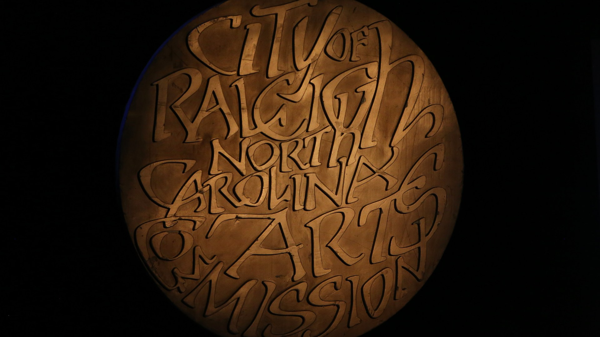 Medal of Arts award which reads City of Raleigh North Carolina Arts Commission
