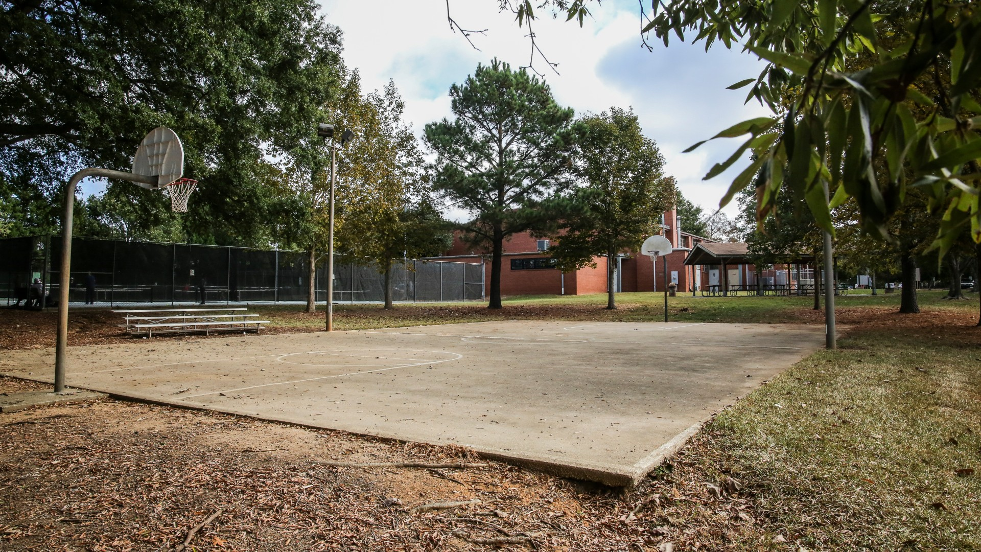 Outdoor basketball court at Method Road Park shows concrete court and two basketball hoops.