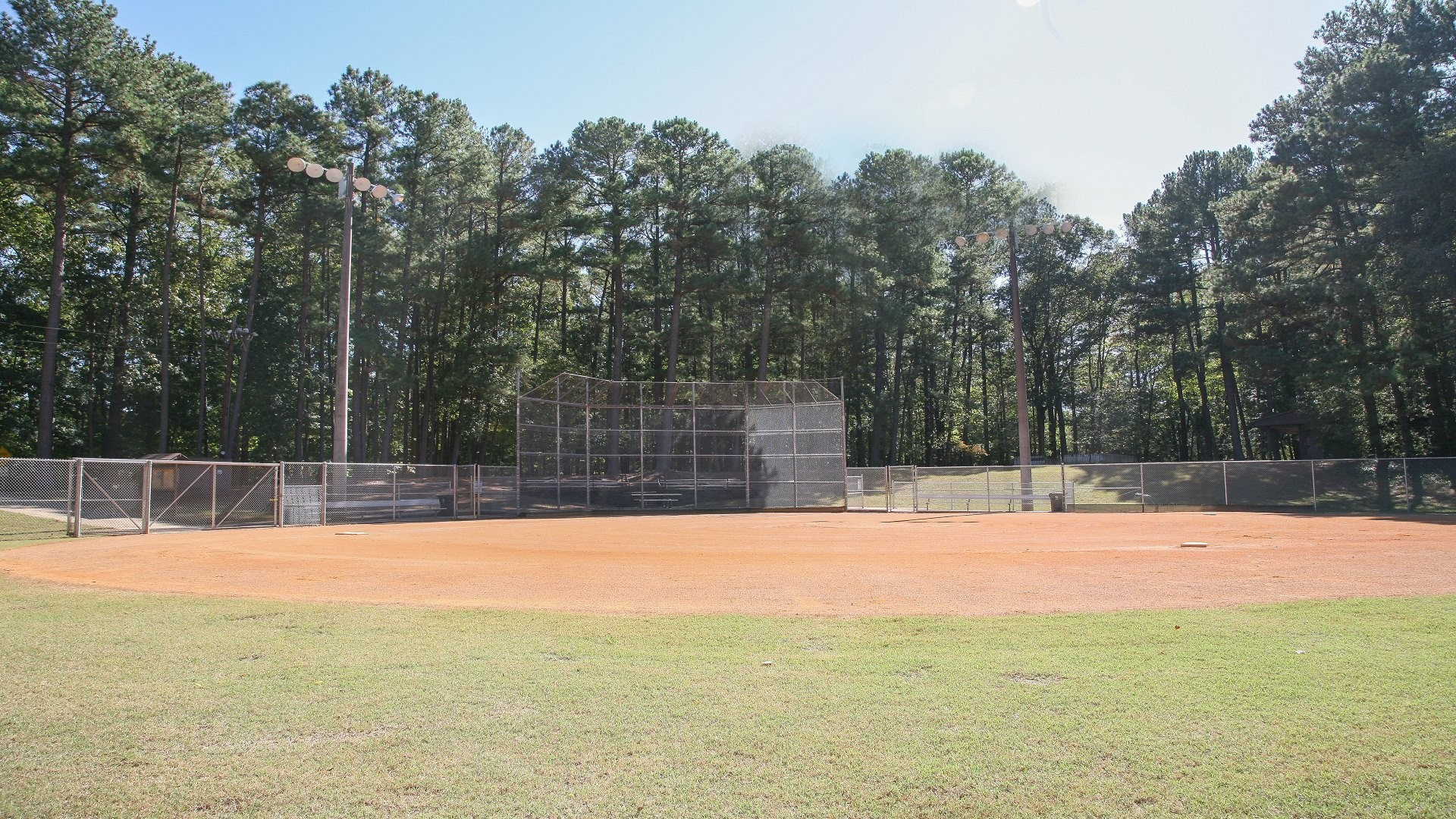 North Hills Park youth baseball field including diamond, benches and fencing.