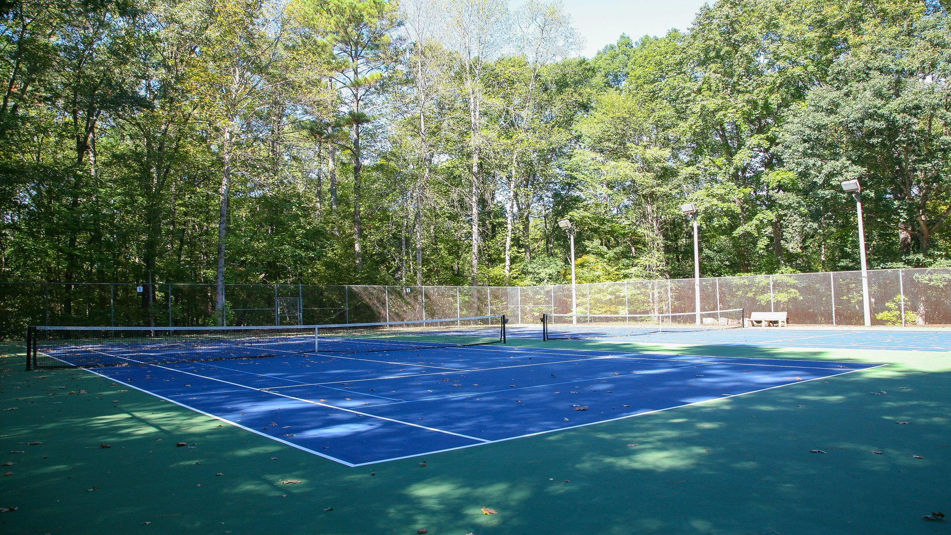 Two outdoor tennis courts at North Hills Park.