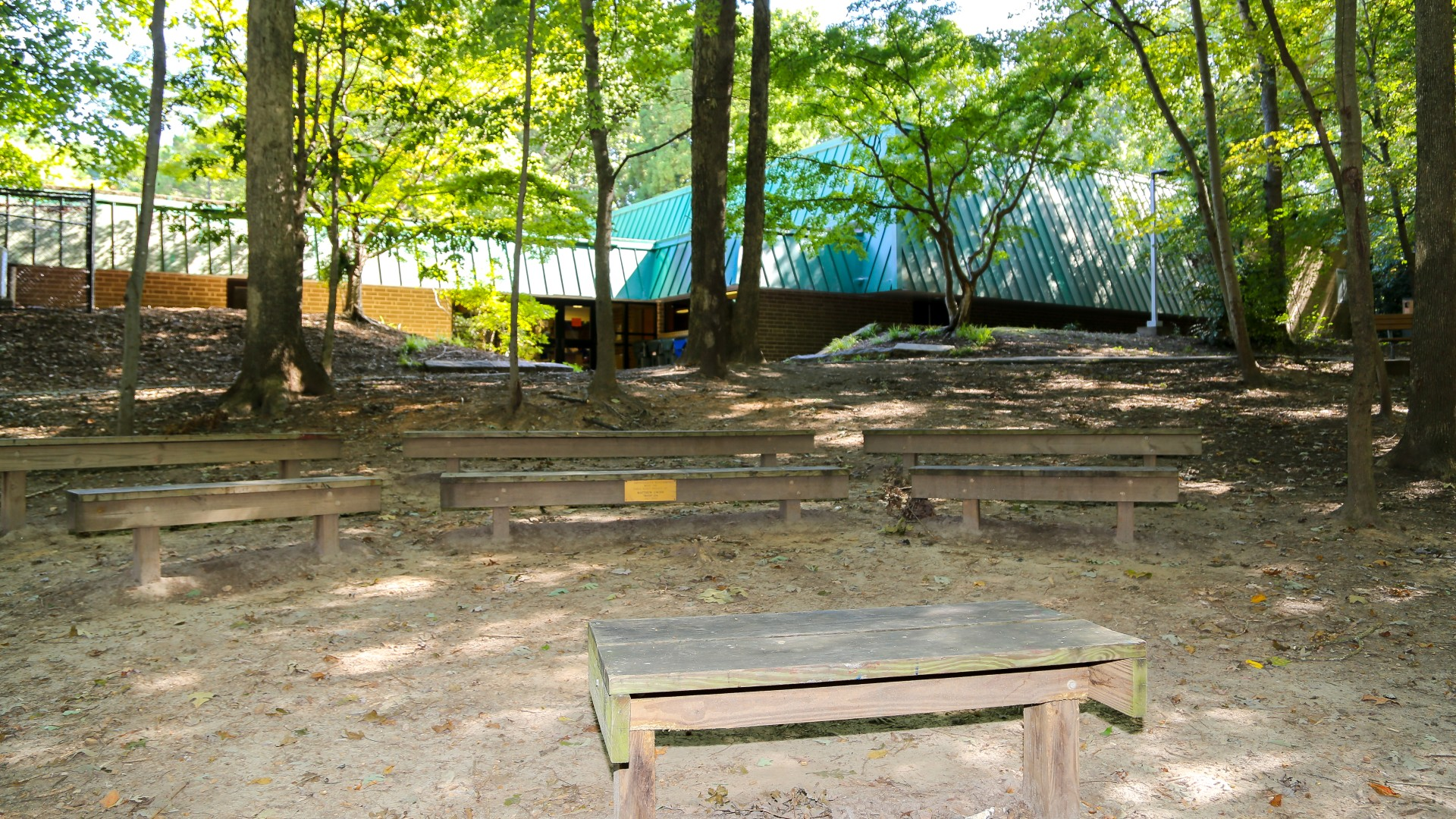 Optimist Park nature amphitheater outdoors featuring a stadium seat layout with several benches