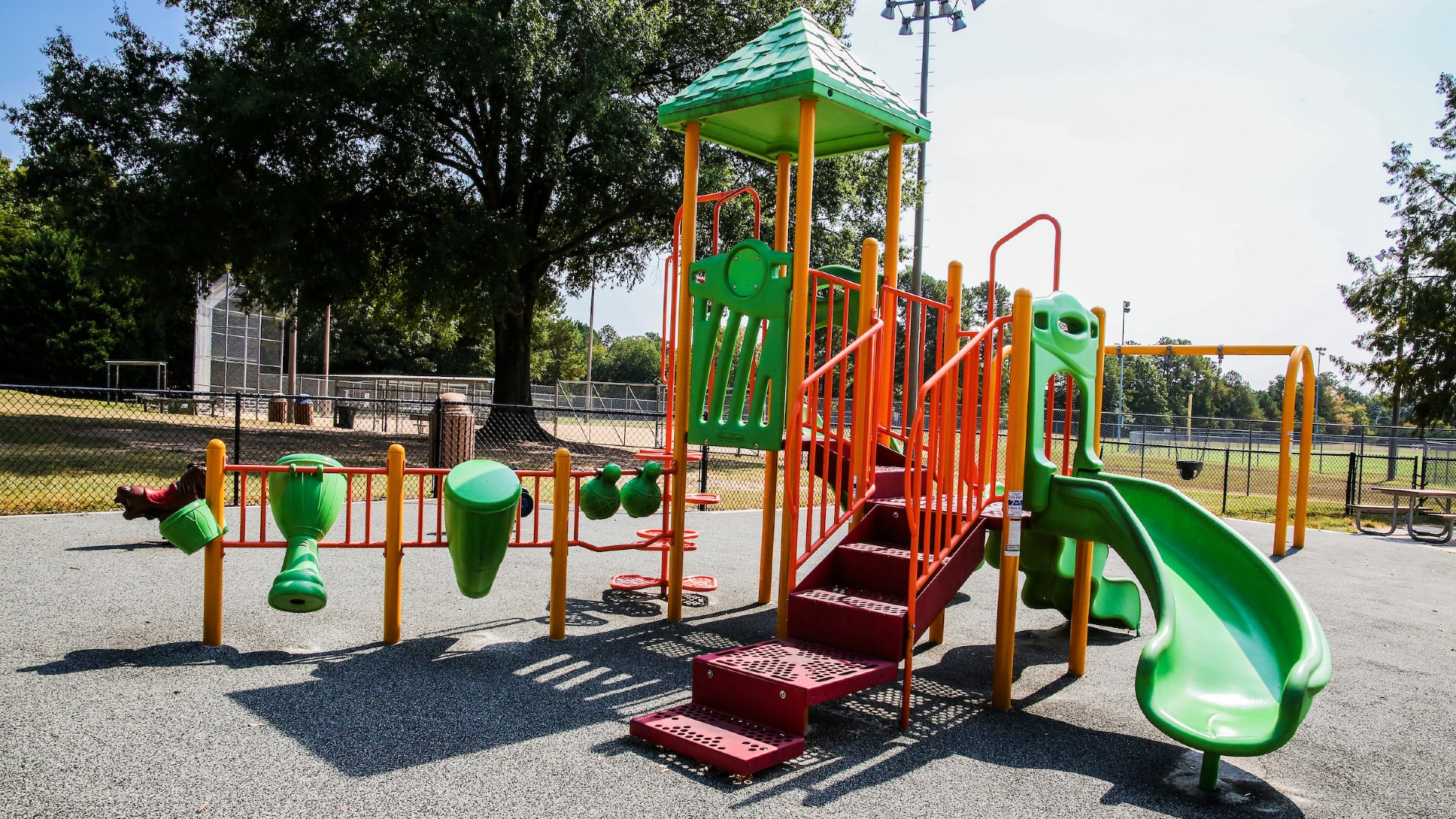 Playground structure with slide, bridge, pole, drums, steps and more