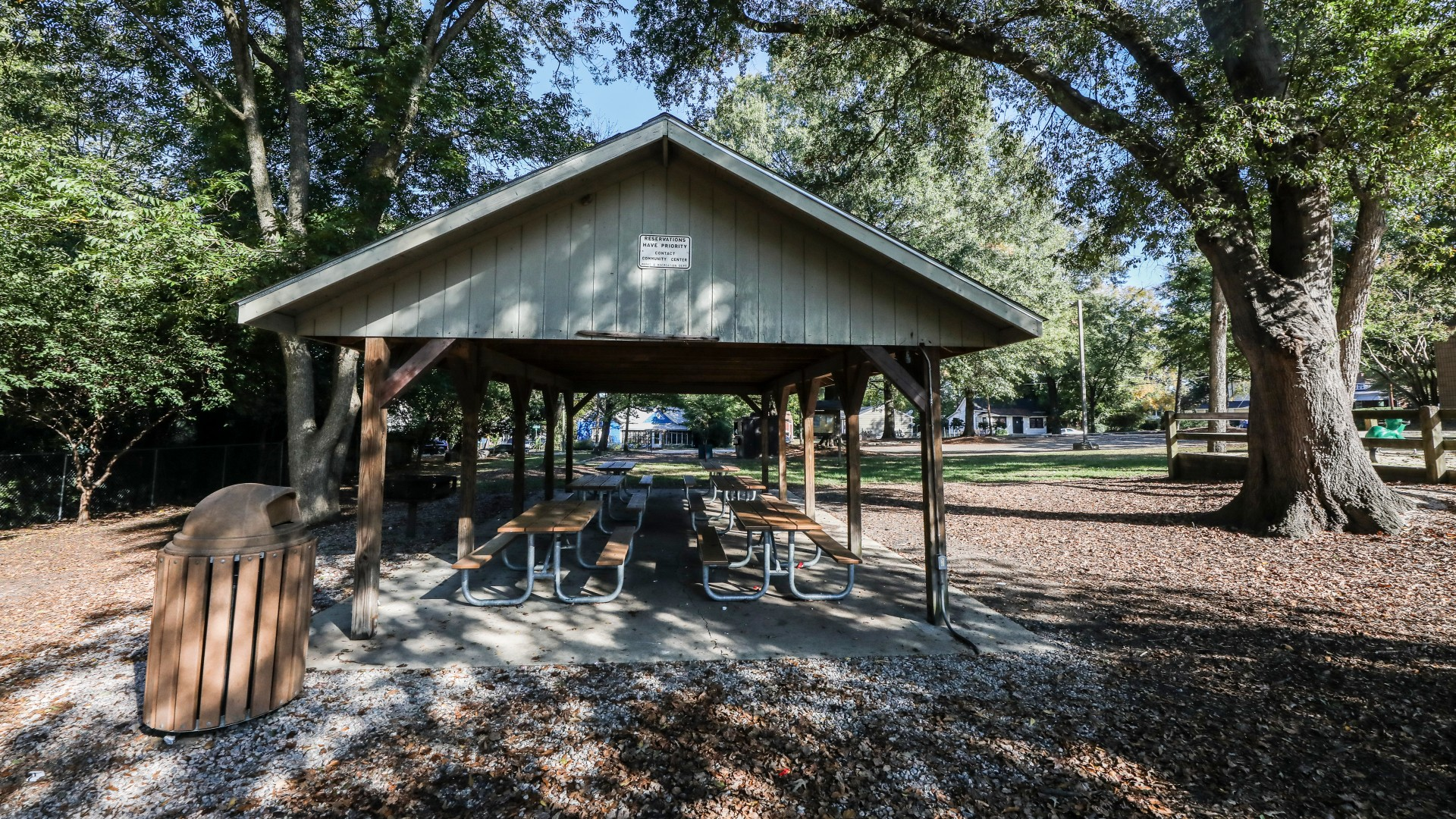 An outdoor picnic shelter with six tables and a grill at tarboro road