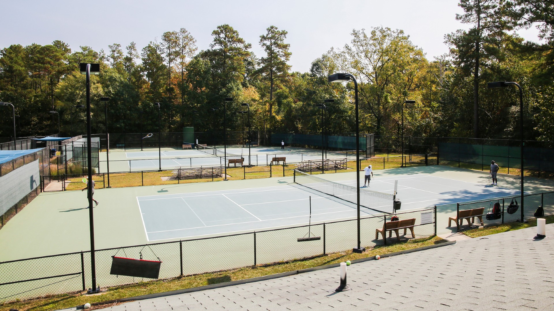 View of four tennis courts at once Millbrook Exchange Park