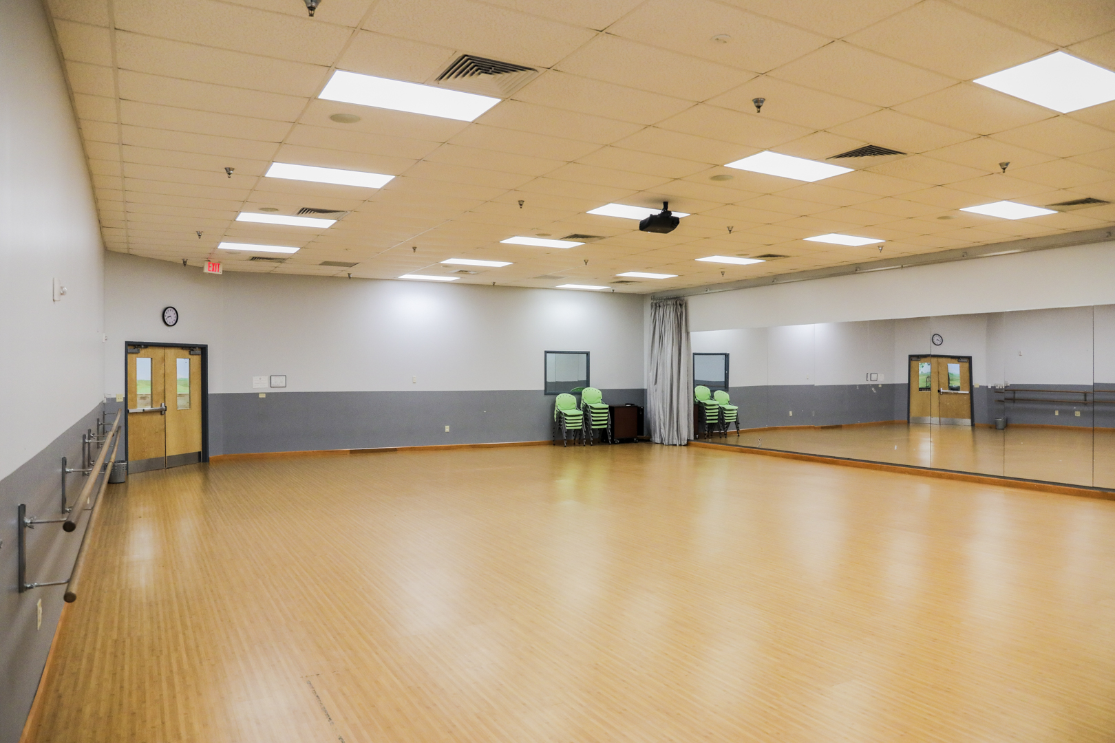 Amenities include a hardwood floor, full length mirrors (with curtain closure), ballet barres, surround sound speakers with CD & IPod capabilities, large screen and ceiling mount projector with Blue Ray capabilities