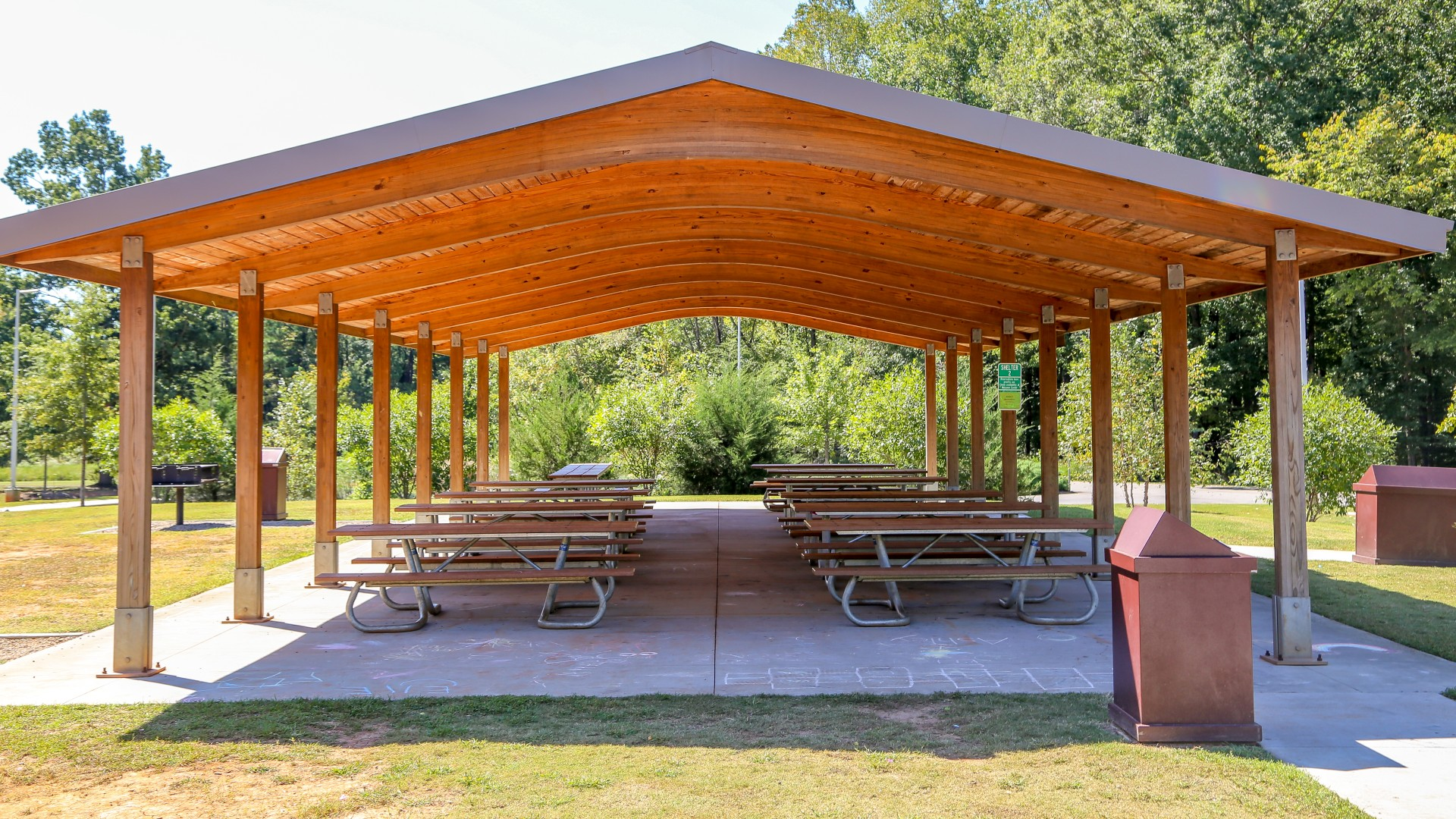 A second slightly smaller picnic shelter with a dozen tables and two grills