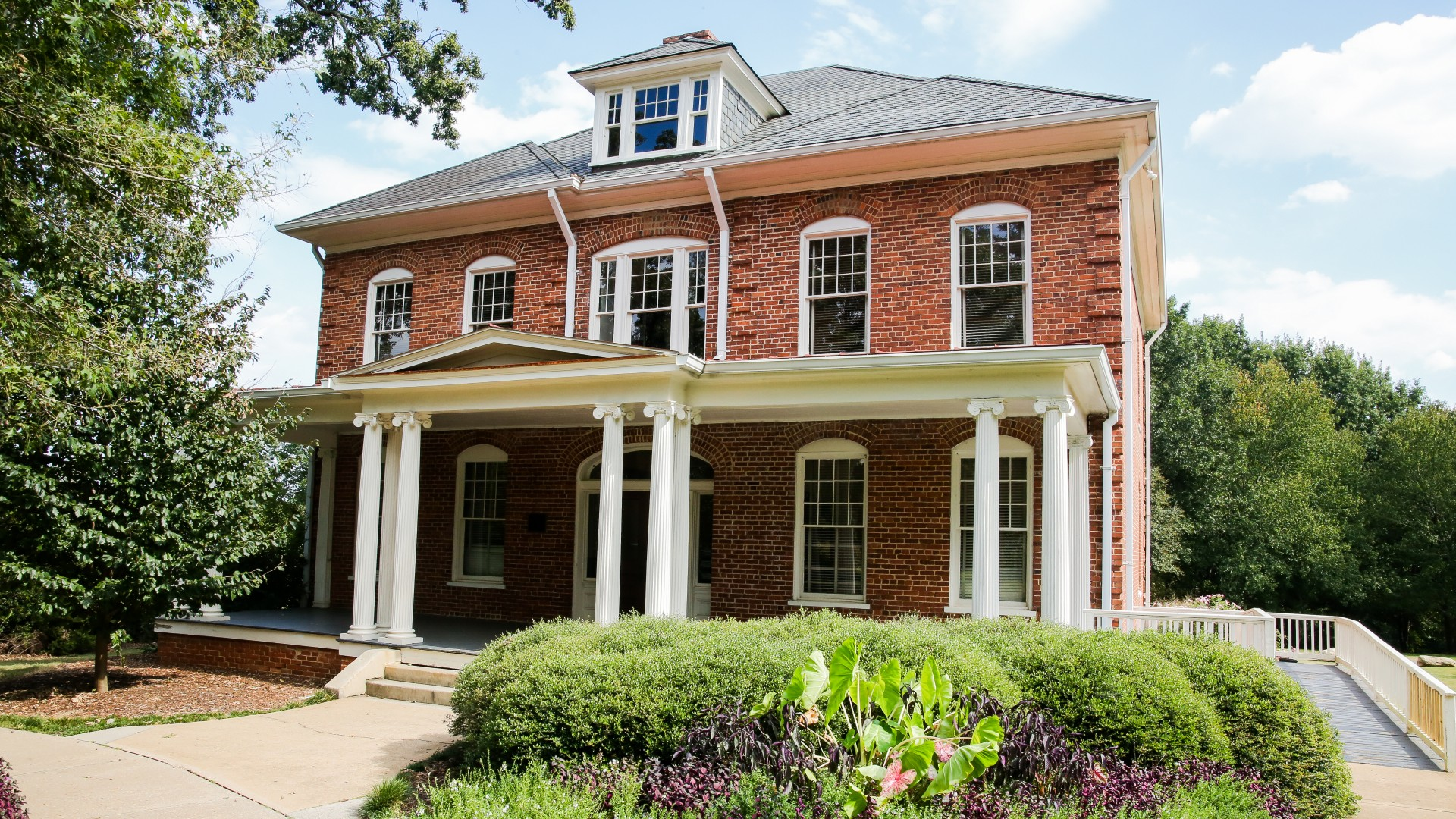 A large brick house that can be rented for special events