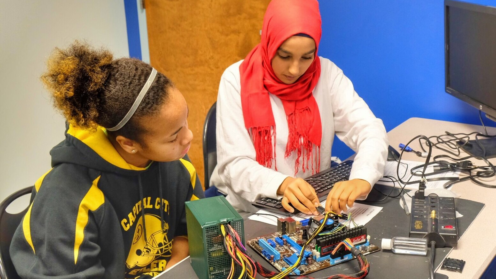 Girls working on motherboard