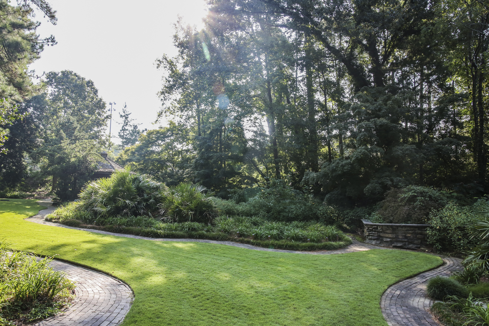 A wide shot of the daylily garden with shrubs, trees, flowers and a gazebo