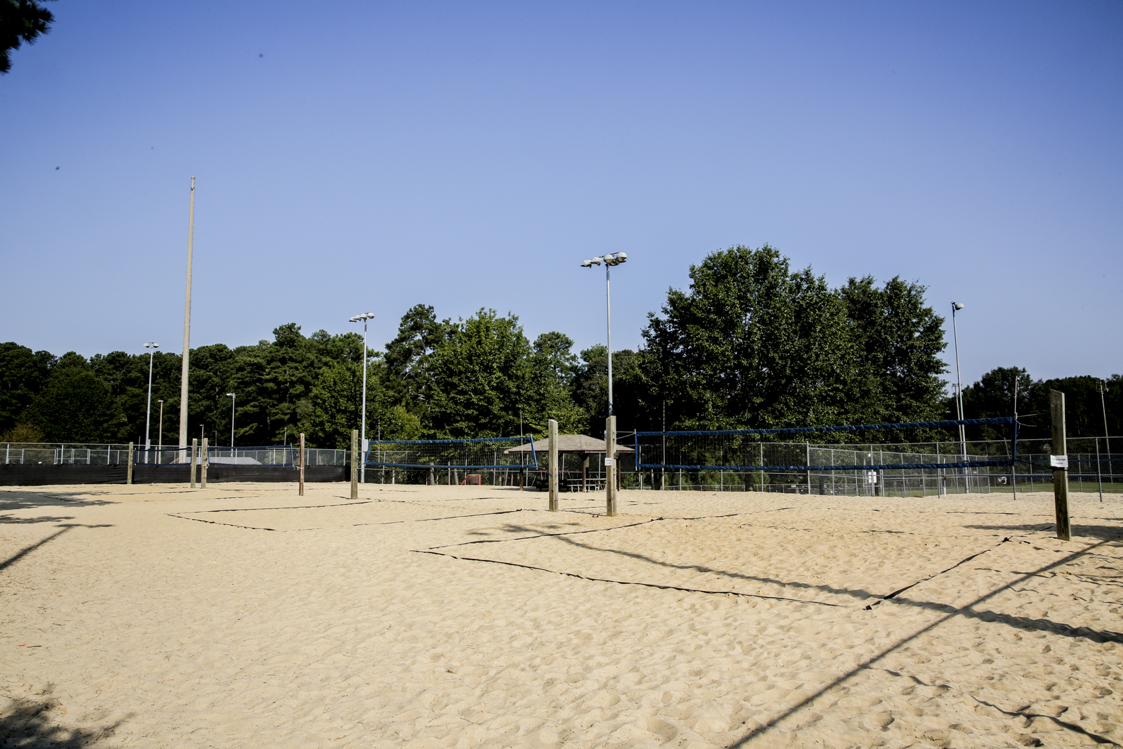Six outdoor sand volleyball courts with lighting