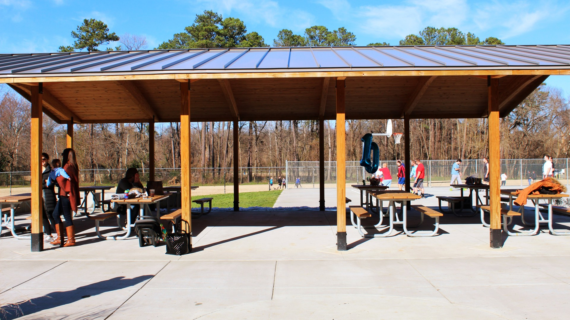 A large open picnic shelter that can accommodate up to 80