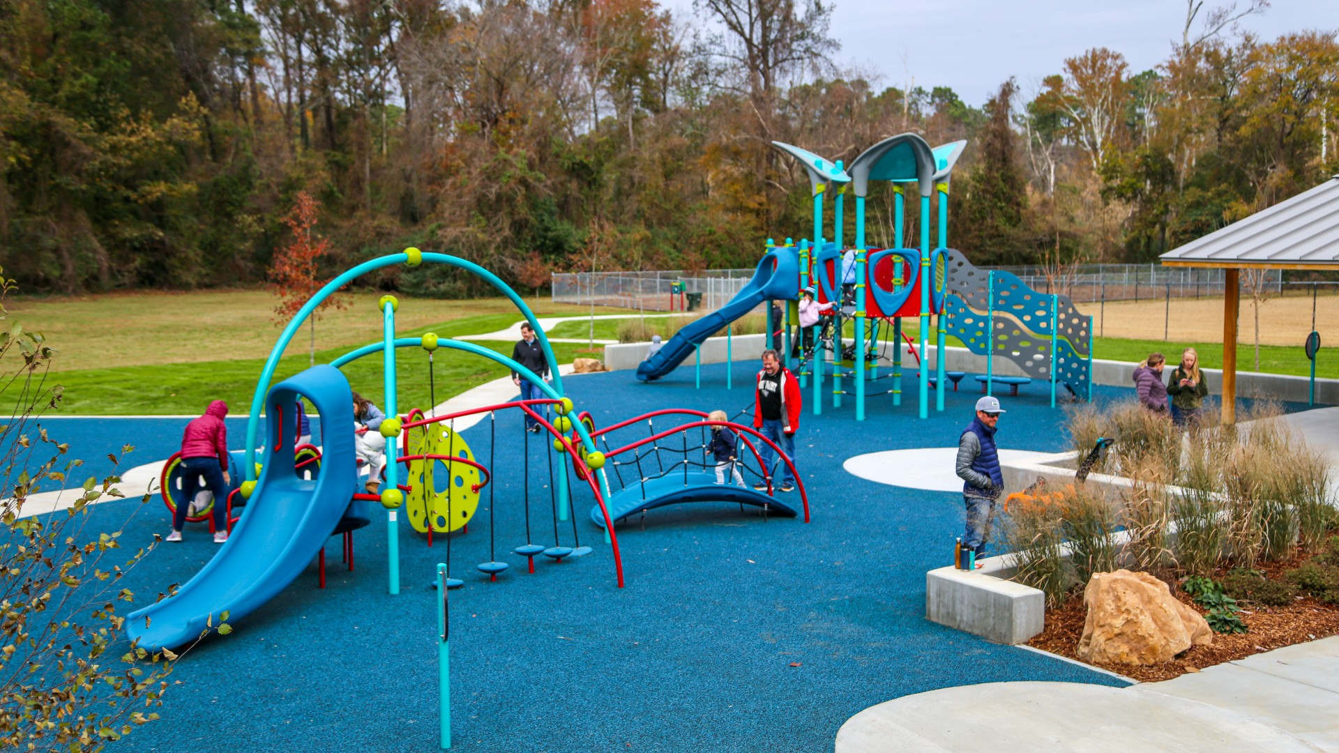 A large outdoor playground with many climbing surfaces