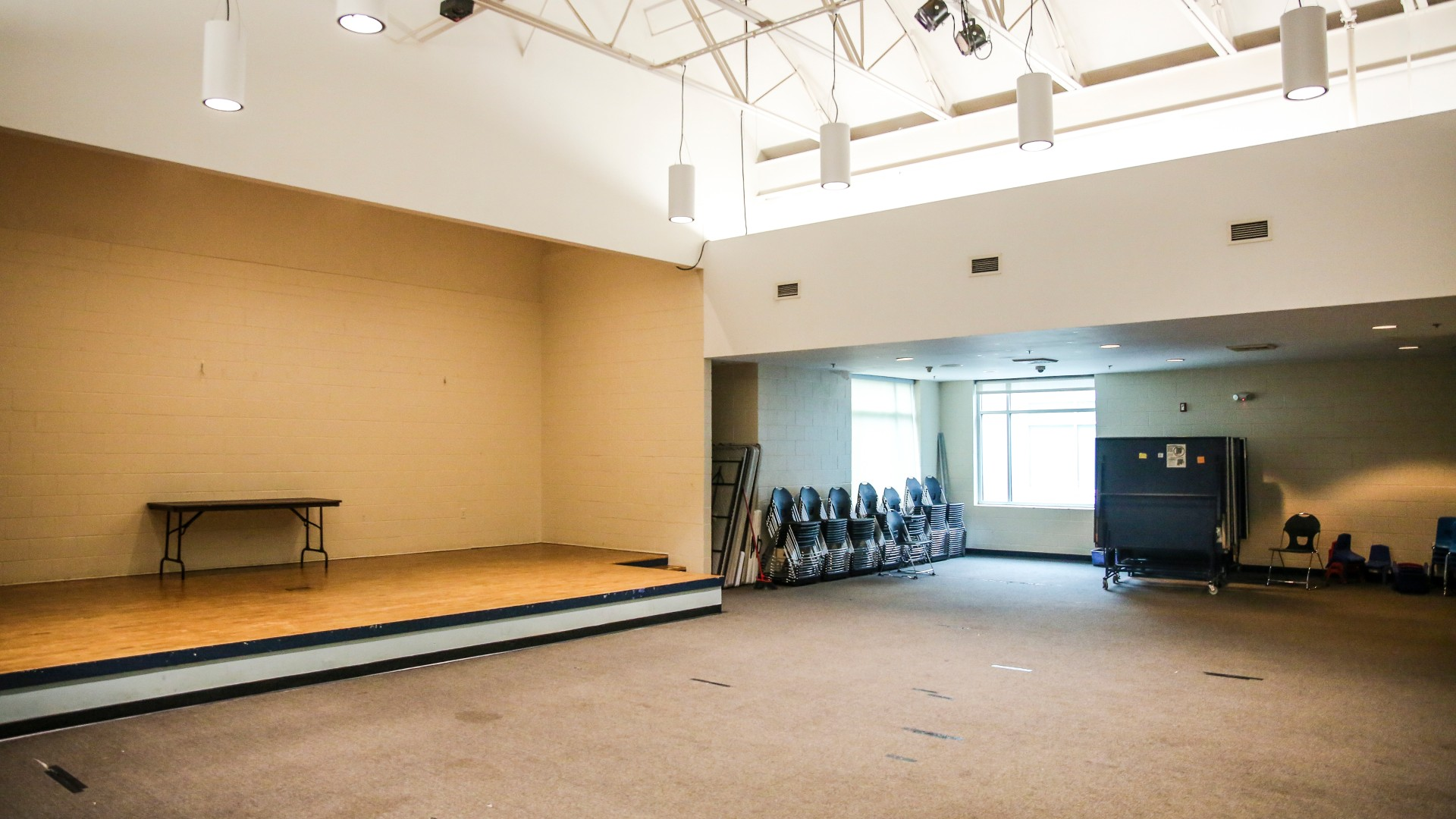 A large meeting room with a stage