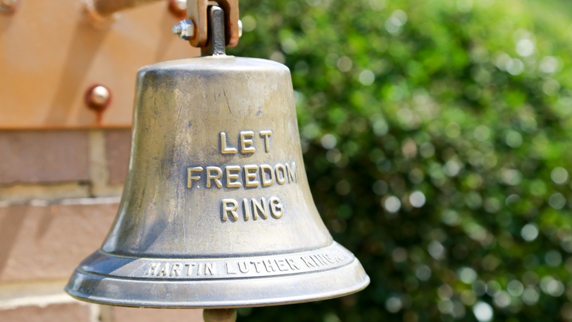 "A bell which reads ""let freedom ring"" at the MLK Gardens"