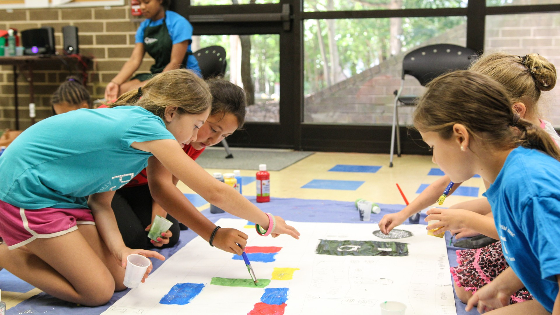 Kids participating in an art program at Optimist